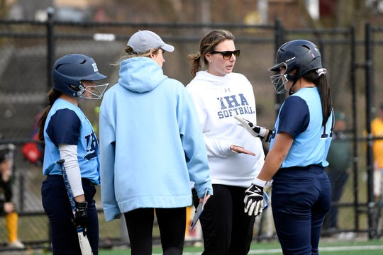 Immaculate Heart Academy head coach Diana Fasano, second from right, high-fives Gabby Park, far right, after her RBI single. IHA defeats Morris Knolls 8-5 to win the first-ever NFCA New Jersey Leadoff Classic on Sunday, April 7, 2019, in Newark. This first Leadoff Classic is in honor of Anthony LaRezza, the former Immaculate Heart Academy coach who passed away in February 2016 after battling cancer.