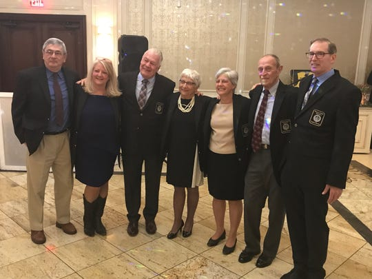 The second annual Paramus Catholic Legacy Gala honored nine contributors to the school's athletic programs, including the late Anne Donovan, on Saturday, April 6, 2019. From left: Mike Glynn (track/cross-country), Heather Messer (dance/cheer), Al Roth (girls basketball), Dr. Rose Battaglia (girls basketball), Beth DelVecchio (AD/softball/girls volleyball), George Bellin (AD/football) and Ron Sparagoski (track/cross-country). Not pictured: Former AD Sister Lawrence Mahon.