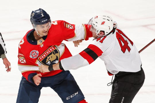 New Jersey Devils center Michael McLeod (41) and Florida Panthers defenseman Josh Brown (2) fight during the third period of an NHL hockey game, Saturday, April 6, 2019, in Sunrise, Fla. The Devils defeated the Panthers 4-3.