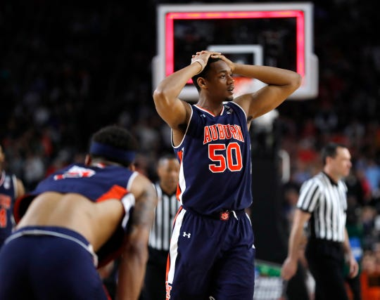 Auburn center Austin Wiley reacts at the end of a semifinal round game against Virginia in the Final Four NCAA college basketball tournament, Saturday, April 6, 2019, in Minneapolis.