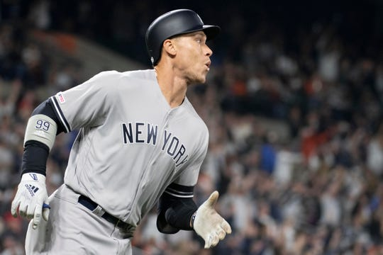 Apr 6, 2019; Baltimore, MD, USA;  New York Yankees right fielder Aaron Judge (99) reacts after hitting a two run home run during the third inning against the Baltimore Orioles at Oriole Park at Camden Yards.