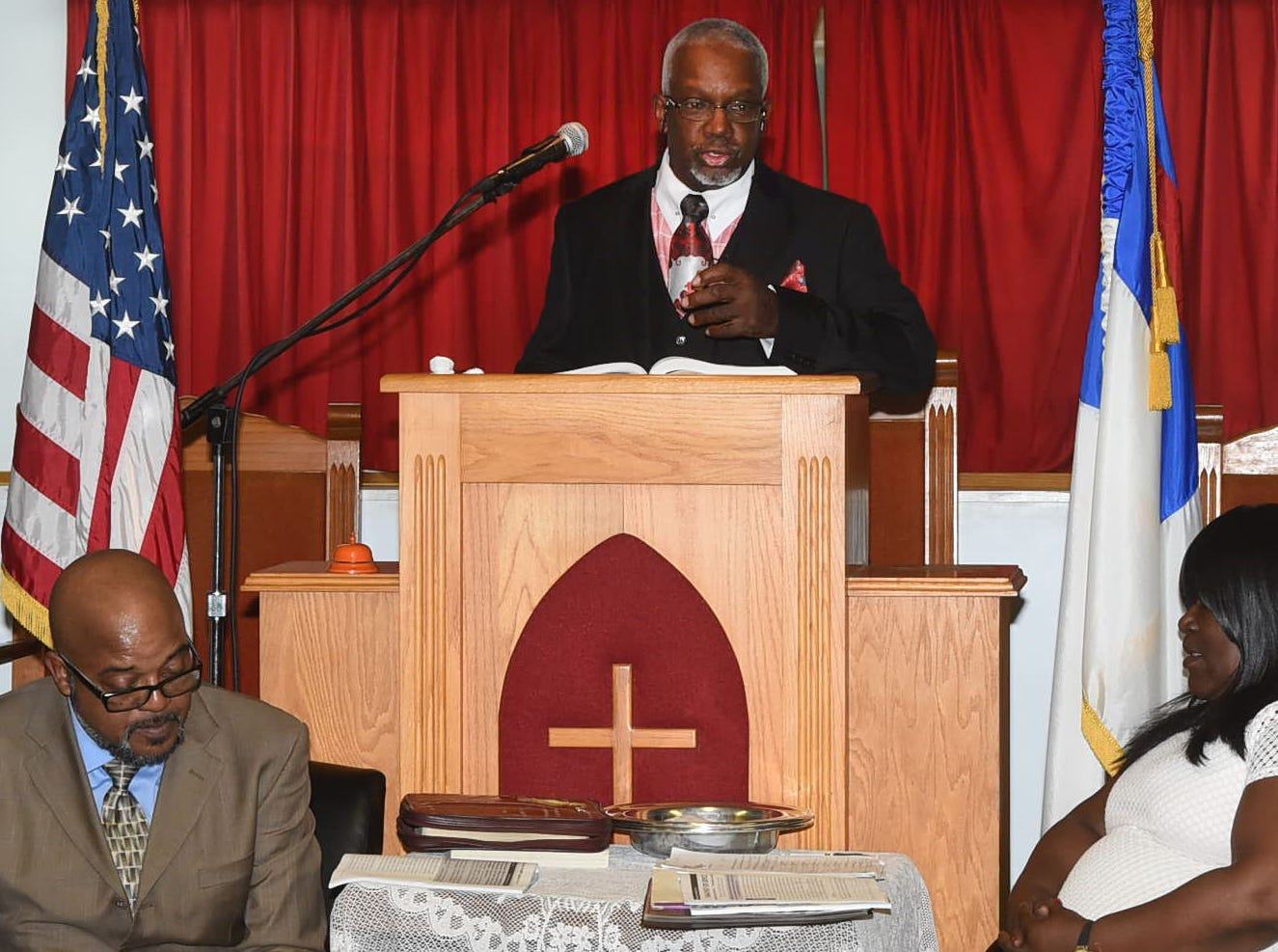 Rev. Gerald Toussaint leads the congregation in prayer Sunday at Morning Star Baptist Church. Special guests were members of the Mt. Pleasant Baptist Church that was destroyed by a fire three days ago.