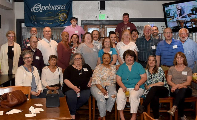 Daily World employees past and present appear in a group shot taken at Saturday night's reunion at Frank's in downtown Opelousas.