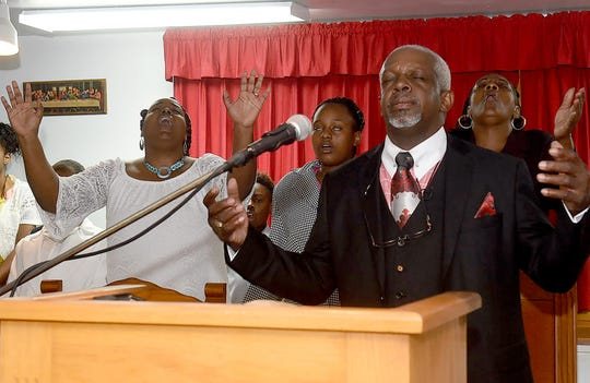 The Rev. Gerald Toussaint, pastor of Mount Pleasant Baptist Church, gives his sermon Sunday at Morning Star Baptist Church where congregants from Mount Pleasant Baptist Church, one of three churches destroyed by fire over the last week, gathered for Sunday services.