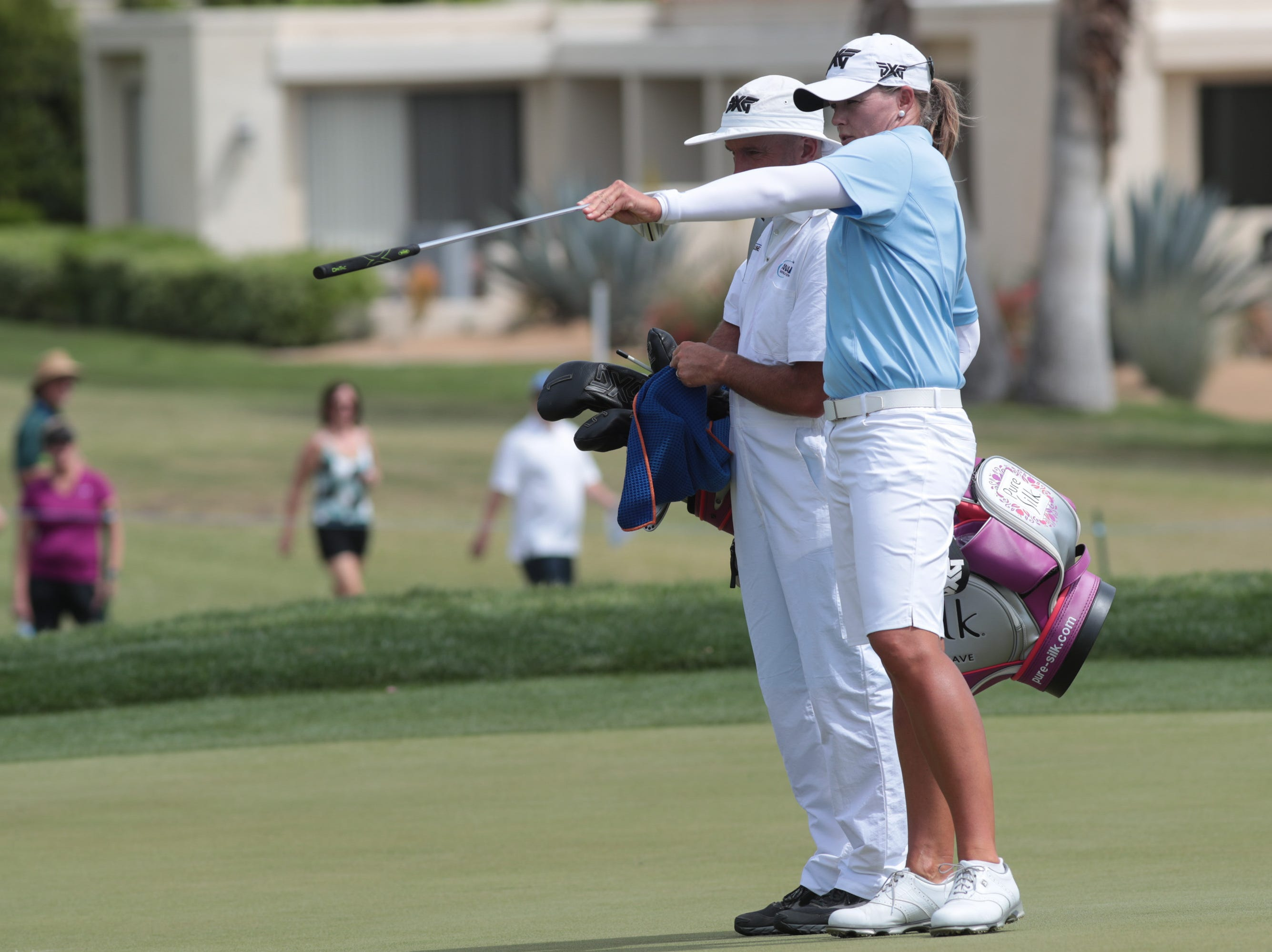 Katherine Kirk prepares for a putt with her caddie on the first hole of the Dinah Shore Course at the ANA Inspiration, Rancho Mirage, Calif., April 6, 2019.