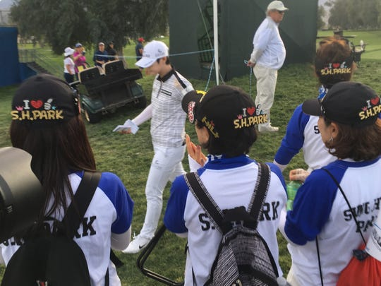 A group of fans follow the world's No. 1 player Sung Hyun Park during her round on Thursday.