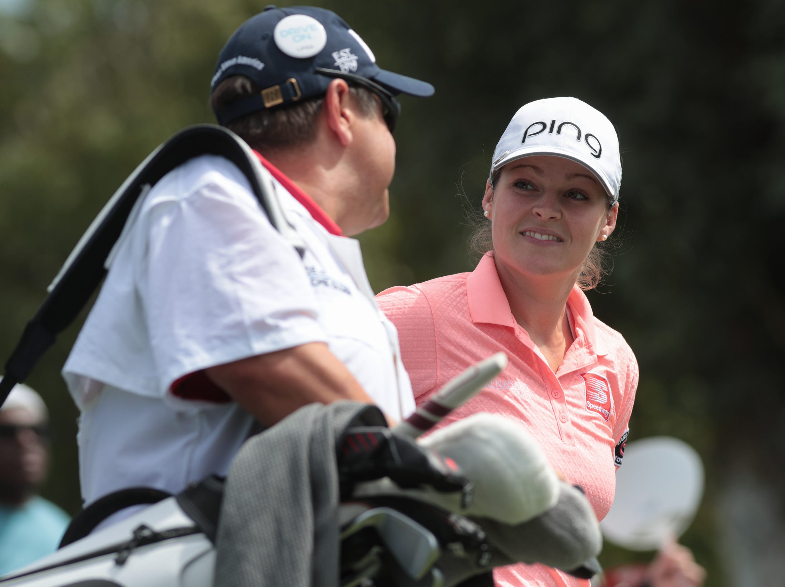 Ally McDonald talks to her caddie after teeing off on the first hole of the Dinah Shore Course at the ANA Inspiration, Rancho Mirage, Calif., April 6, 2019.
