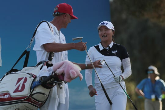 Jin Young Ko exchanges a laugh with her caddie after teeing off on the 17th hole of the Dinah Shore Course at the ANA Inspiration, Rancho Mirage, Calif., April 6, 2019.