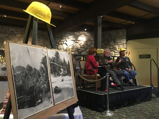 Photos of the Palm Springs Aerial Tramway's construction are visible as Steven Nichols (middle) speaks during a Palm Springs Rotary Club event. He and James Landells (right) explained their parents' involvement in developing the Palm Springs tourist attraction.