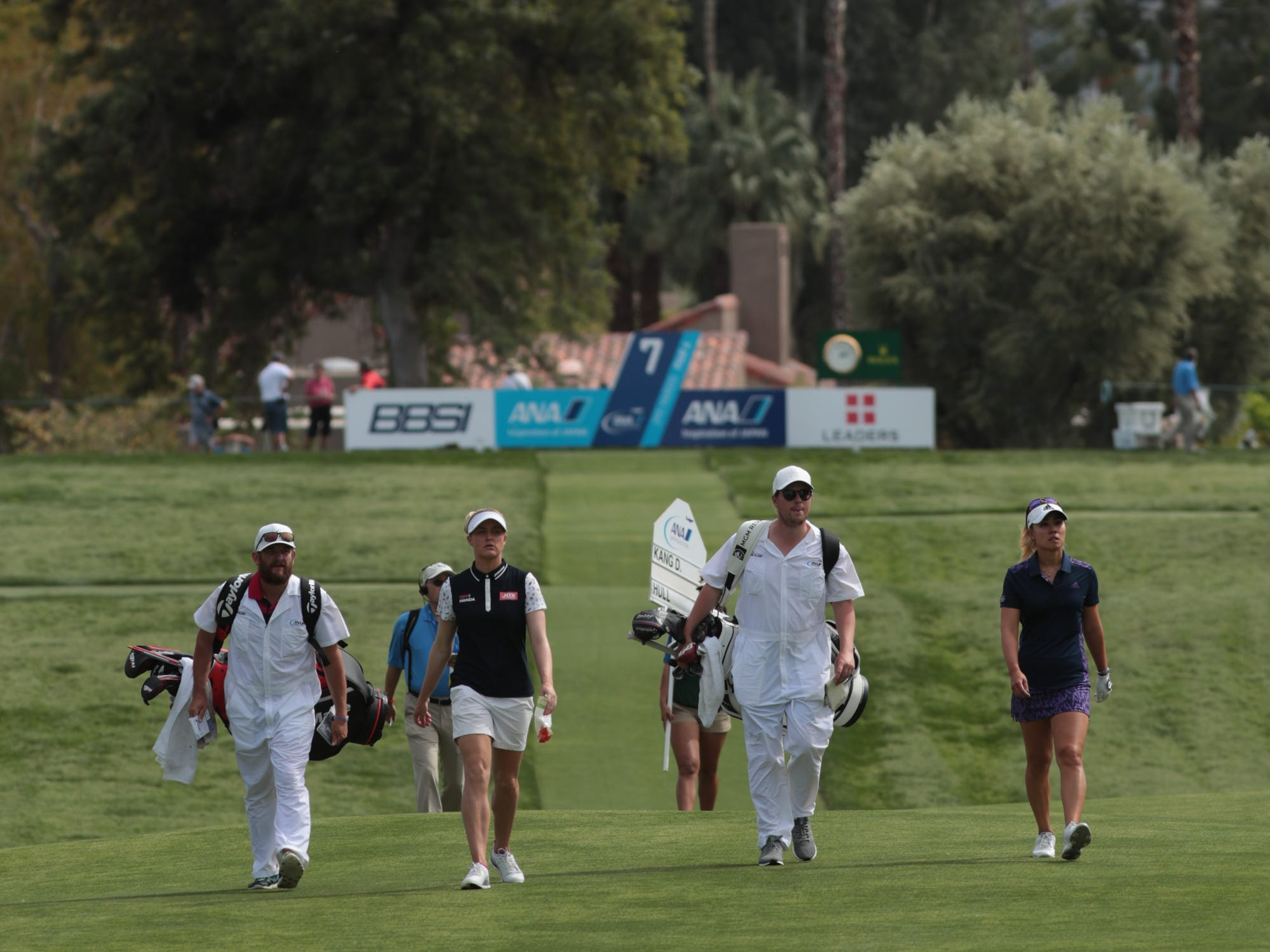 Danielle Kang, far right, and Charley Hull walk down the seventh hole of the Dinah Shore Course at the ANA Inspiration, Rancho Mirage, Calif., April 6, 2019.