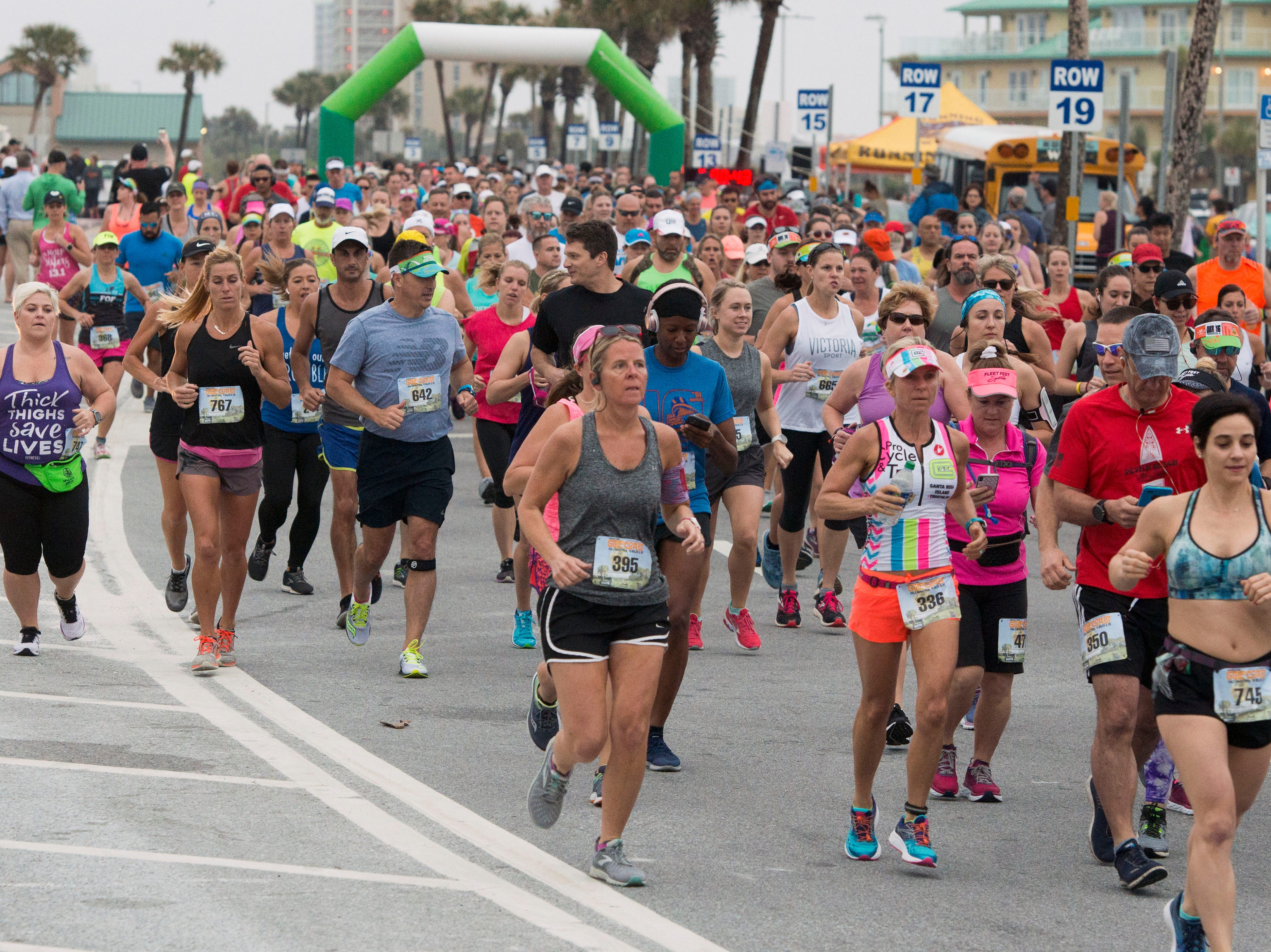 Runners make there way along the course Sunday, April 7, 2019 during the Gulf Coast Half Marathon at Pensacola Beach. The race included a half marathon, 10 miler and 5K.