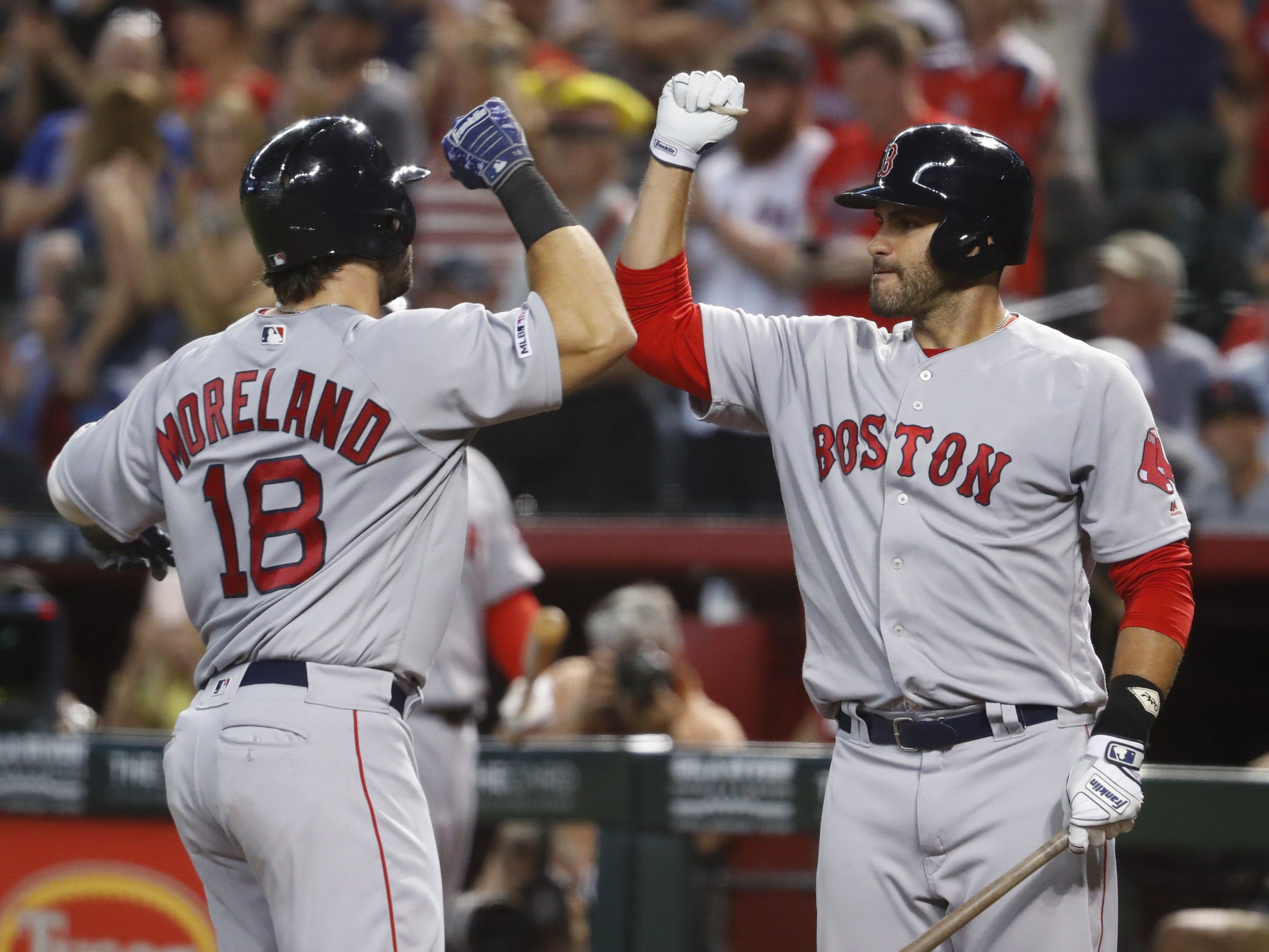 Red Sox Mitch Moreland (18) celebrates with JD Martinez (28) after Moreland hit a solo home run during the seventh inning at Chase Field in Phoenix, Ariz. on April 7, 2019.
