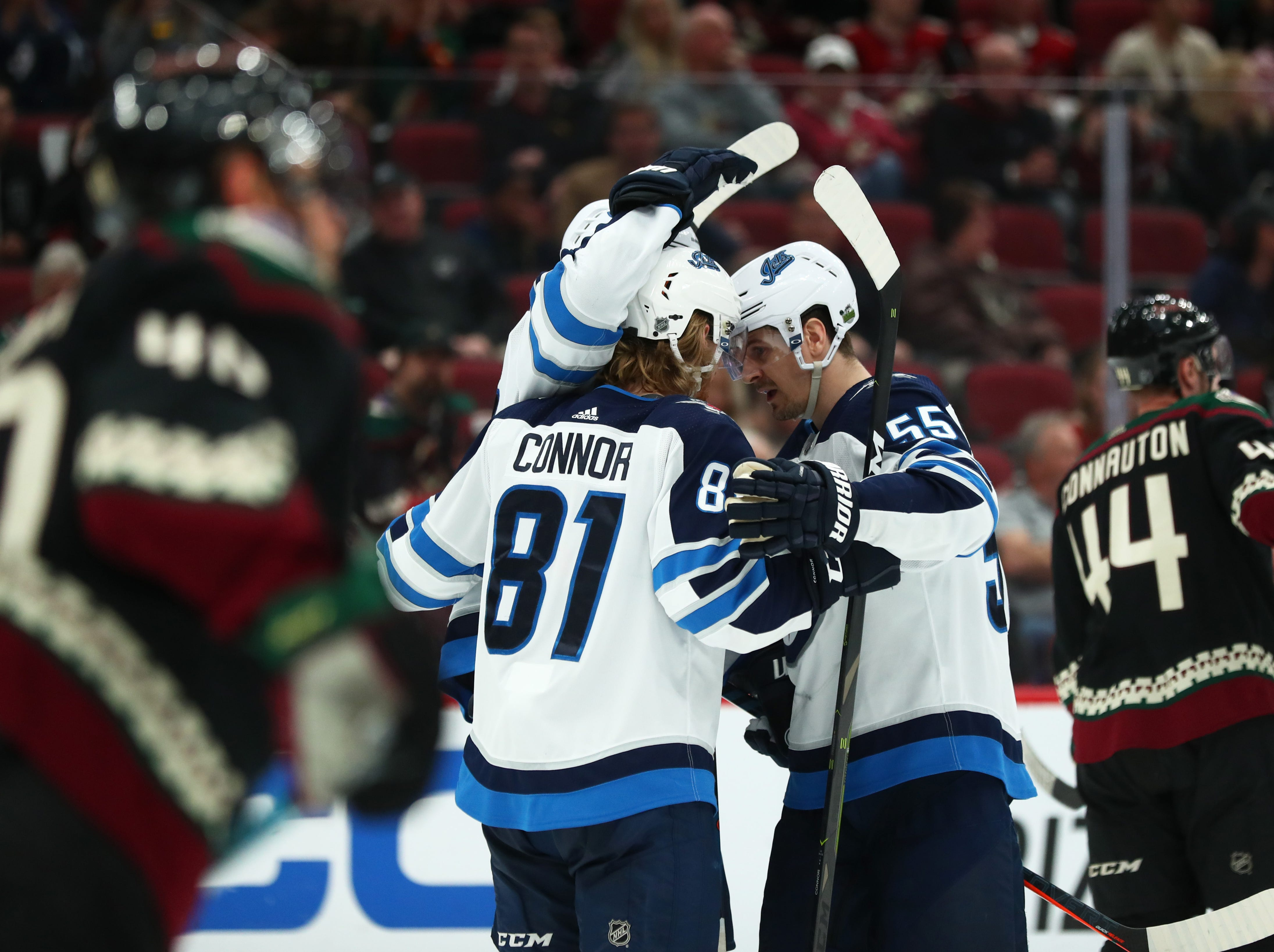 Apr 6, 2019; Glendale, AZ, USA; Winnipeg Jets left wing Kyle Connor (81) celebrates with teammates after scoring a goal against the Arizona Coyotes in the second period at Gila River Arena. Mandatory Credit: Mark J. Rebilas-USA TODAY Sports