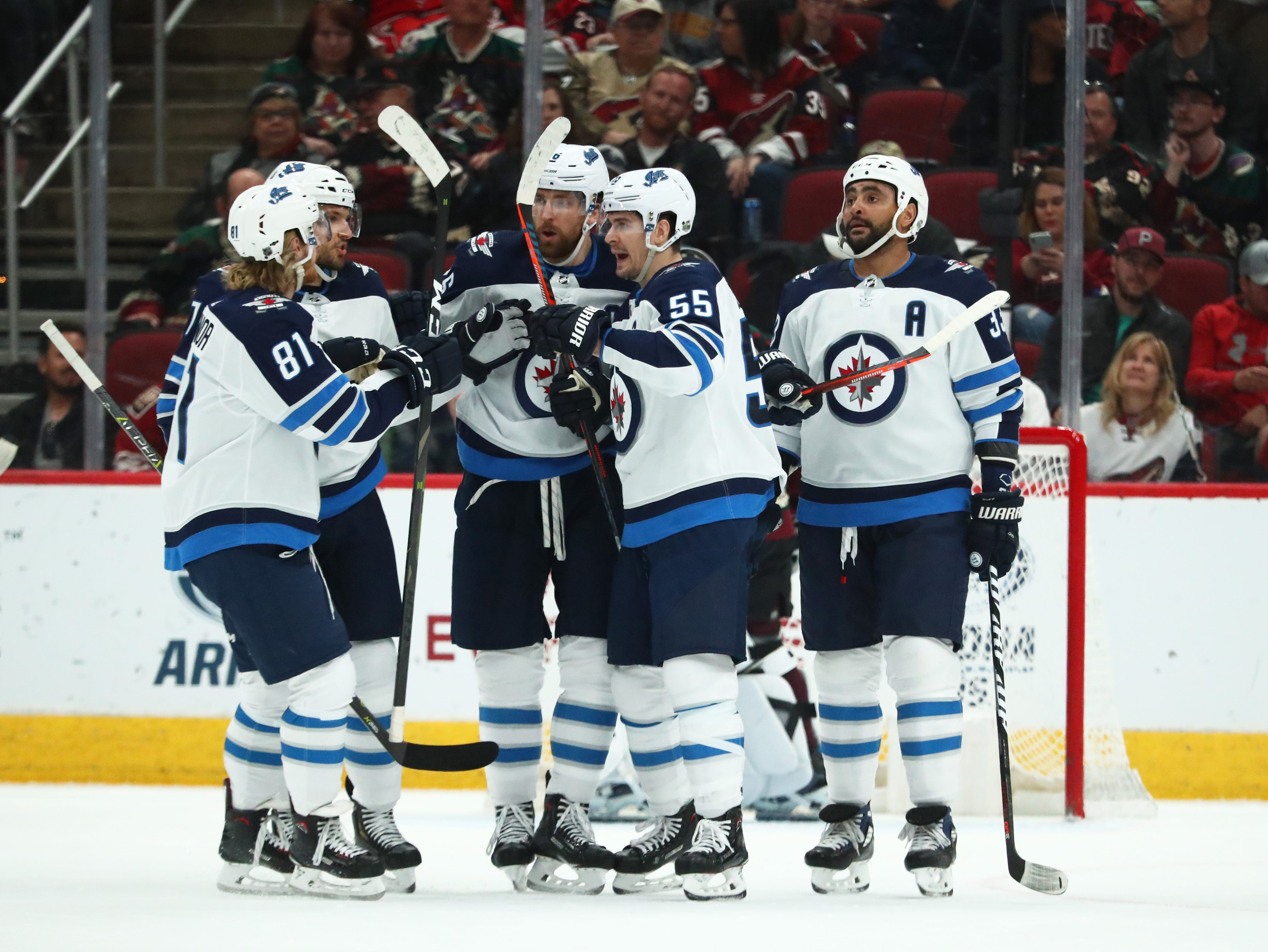 Apr 6, 2019; Glendale, AZ, USA; Winnipeg Jets center Mark Scheifele (55) celebrates with teammates after scoring a goal against the Arizona Coyotes in the first period at Gila River Arena. Mandatory Credit: Mark J. Rebilas-USA TODAY Sports