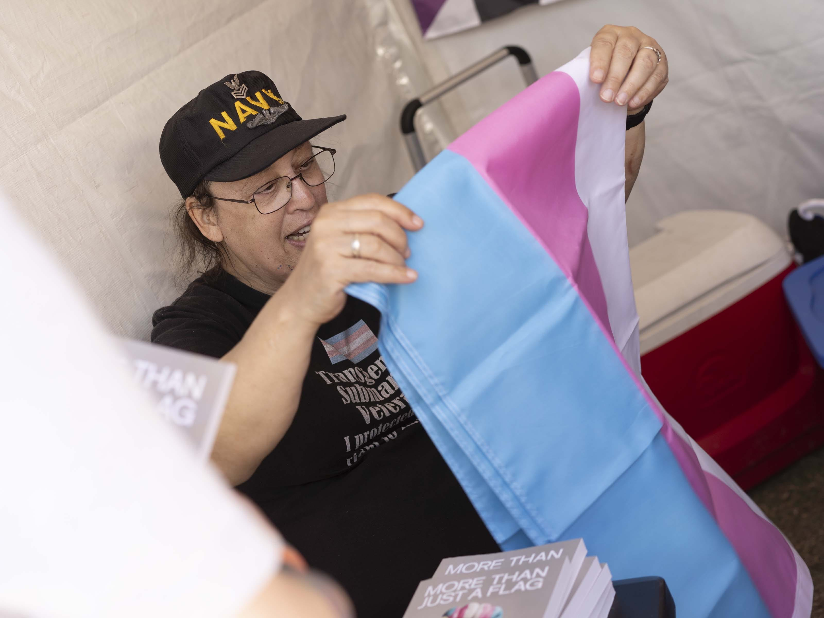 Monica Helms, who created the transgender pride  flag, signs books for fans during Phoenix Pride at Steele Indian School Park on Saturday, April 6, 2019.