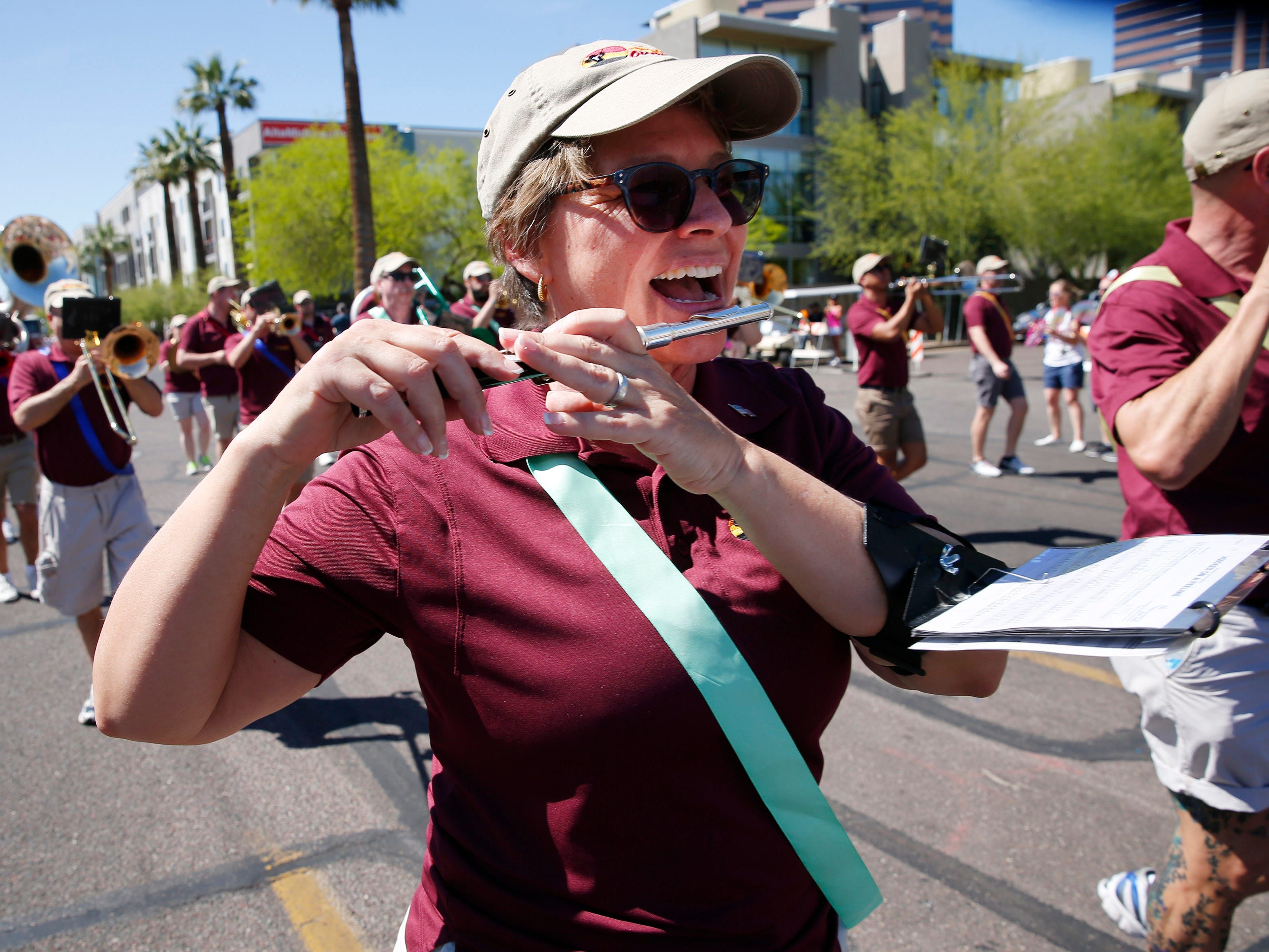 Members of Desert Overture march during the Phoenix Pride Parade on April 7, 2019.