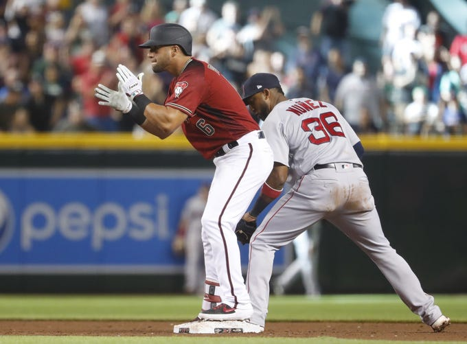 Diamondbacks' David Peralta (6) claps after getting a double against the Red Sox during the ninth inning at Chase Field in Phoenix, Ariz. on April 7, 2019.