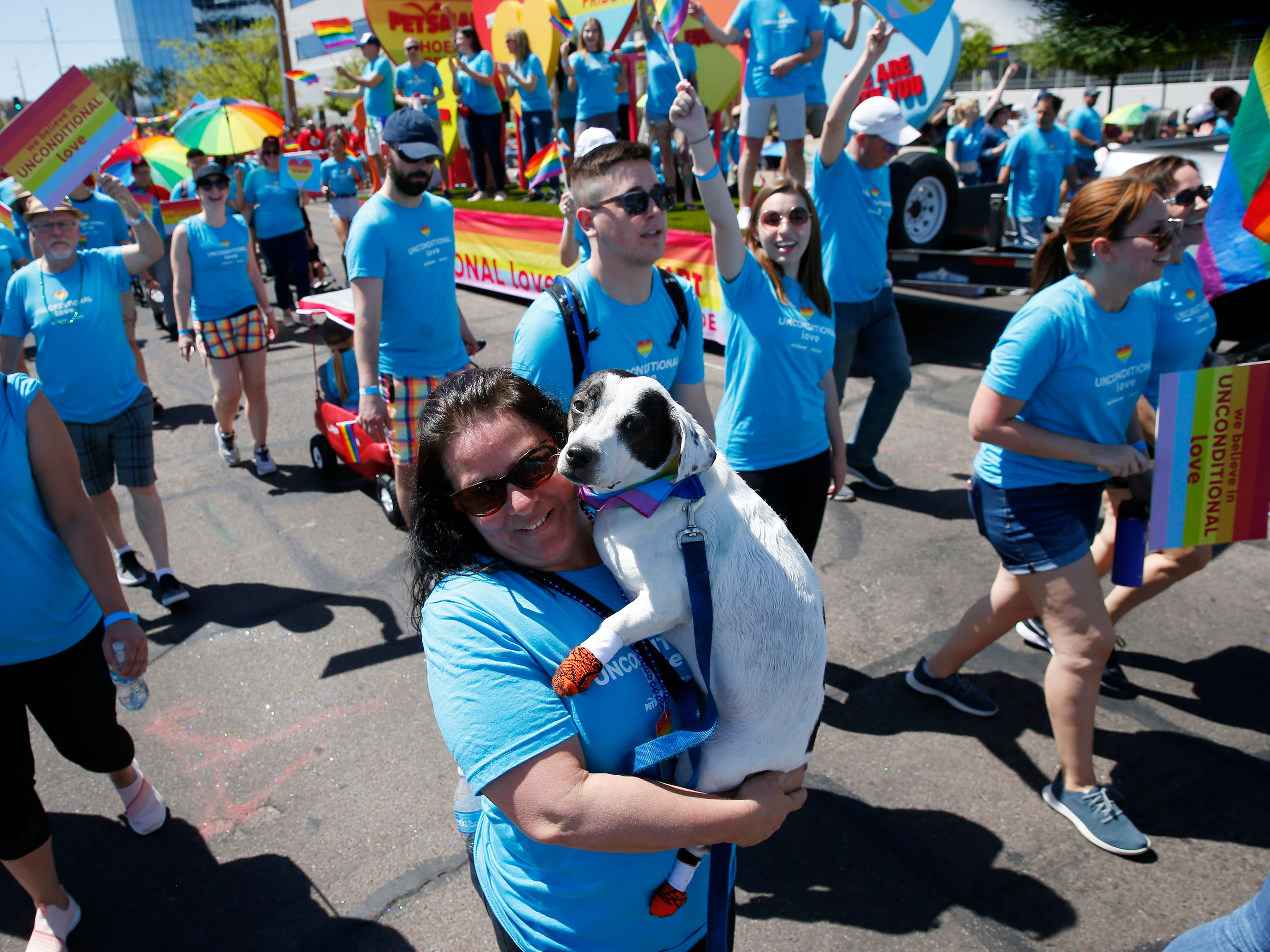 Participants with Petsmart march during the Phoenix Pride Parade on April 7, 2019.