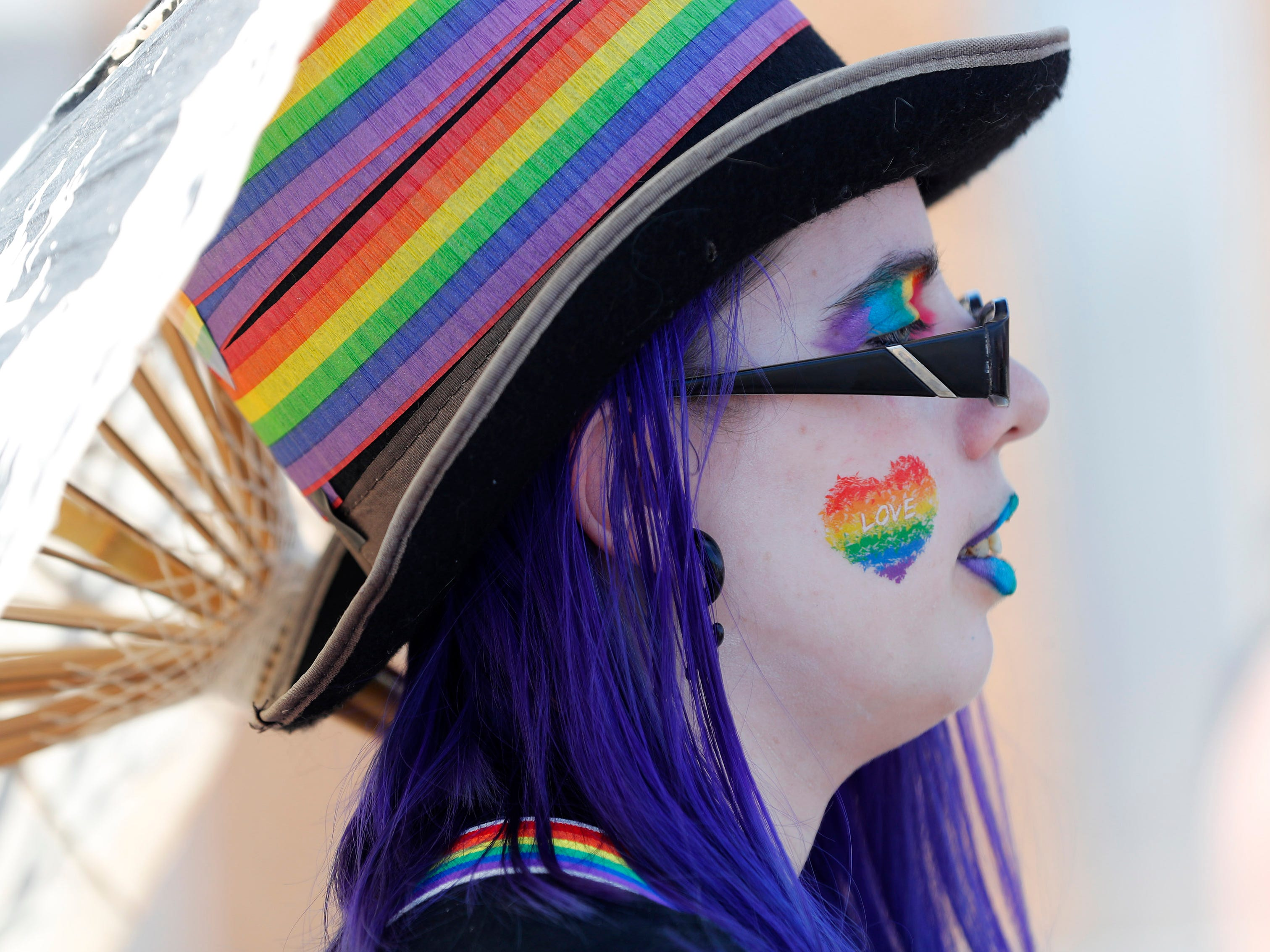 Megan Olson marches with SCNM during the Phoenix Pride Parade on April 7, 2019.