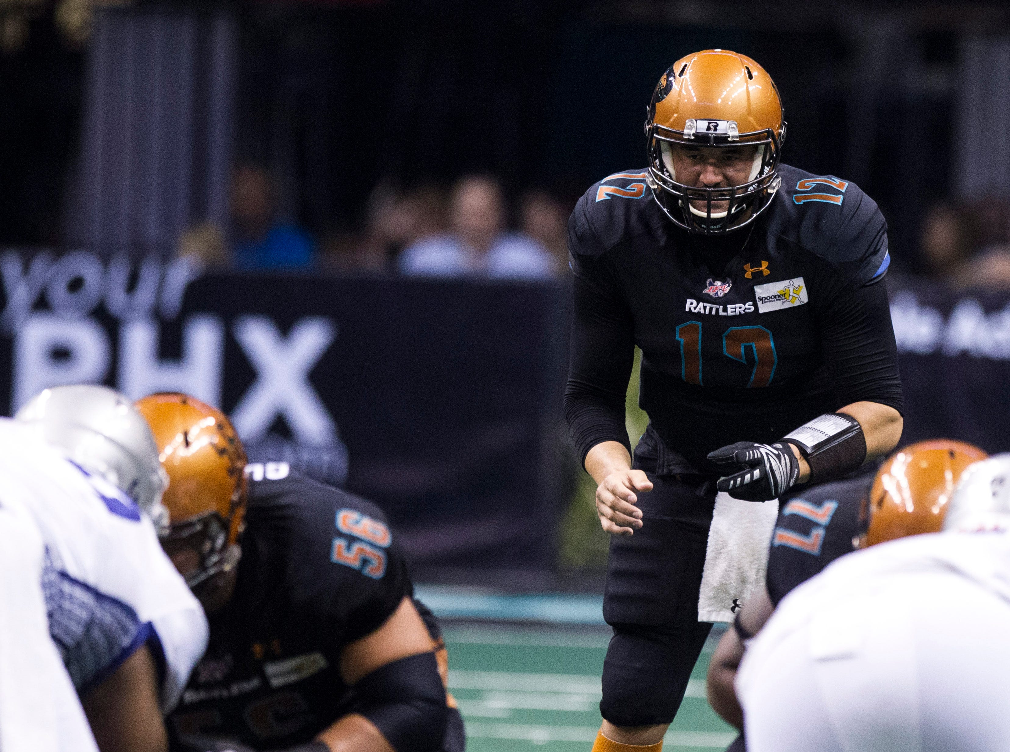 Newly signed Arizona Rattler quarterback Caled Holbrook (12) plays in the second half against the San Diego Strike Force's at Talking Stick Resort Arena in Phoenix Friday, April. 6, 2019.