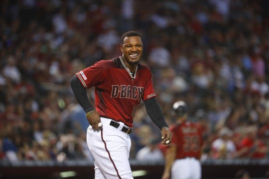 Diamondbacks' Adam Jones (10) leaves the batter box to head to the field against the Red Sox during the fourth inning at Chase Field in Phoenix, Ariz. on April 7, 2019.
