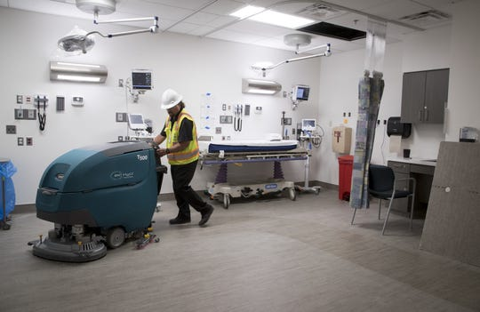 The floors are cleaned in the Emergency Department at the Maricopa Integrated Health System Maryvale campus on April 1, 2019.
