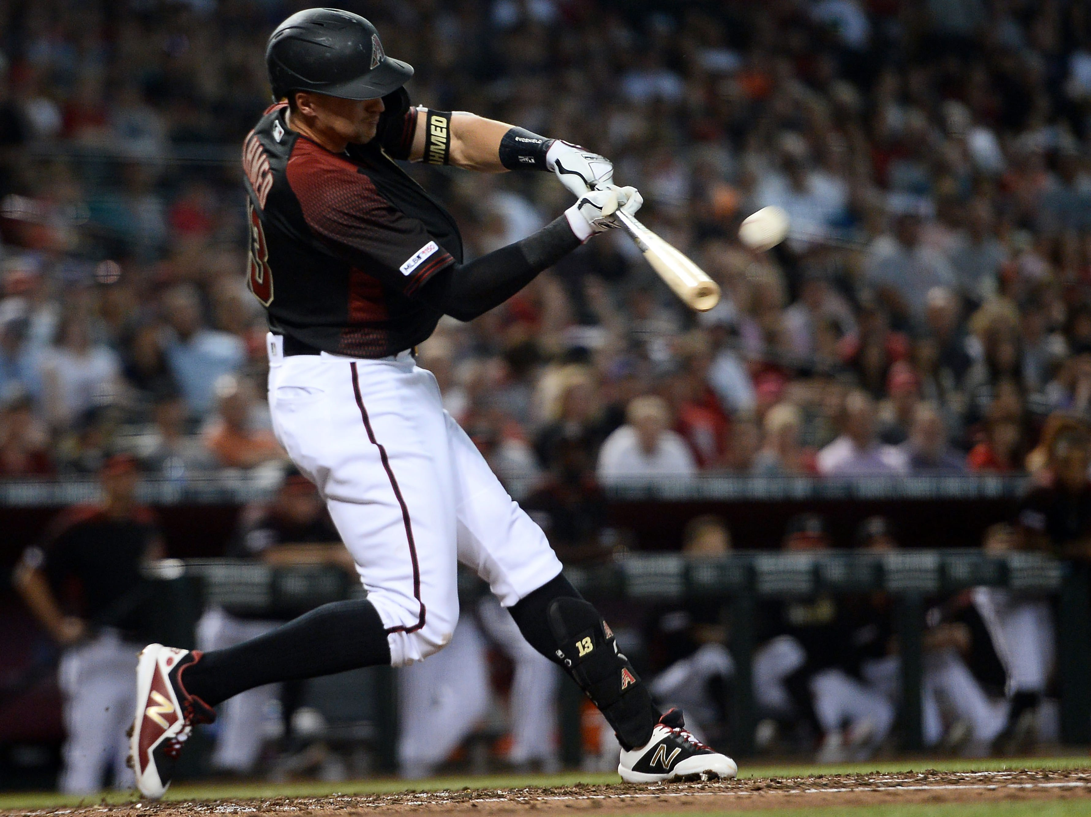 Apr 6, 2019; Phoenix, AZ, USA; Arizona Diamondbacks shortstop Nick Ahmed (13) hits an RBI single against the Boston Red Sox during the second inning at Chase Field. Mandatory Credit: Joe Camporeale-USA TODAY Sports