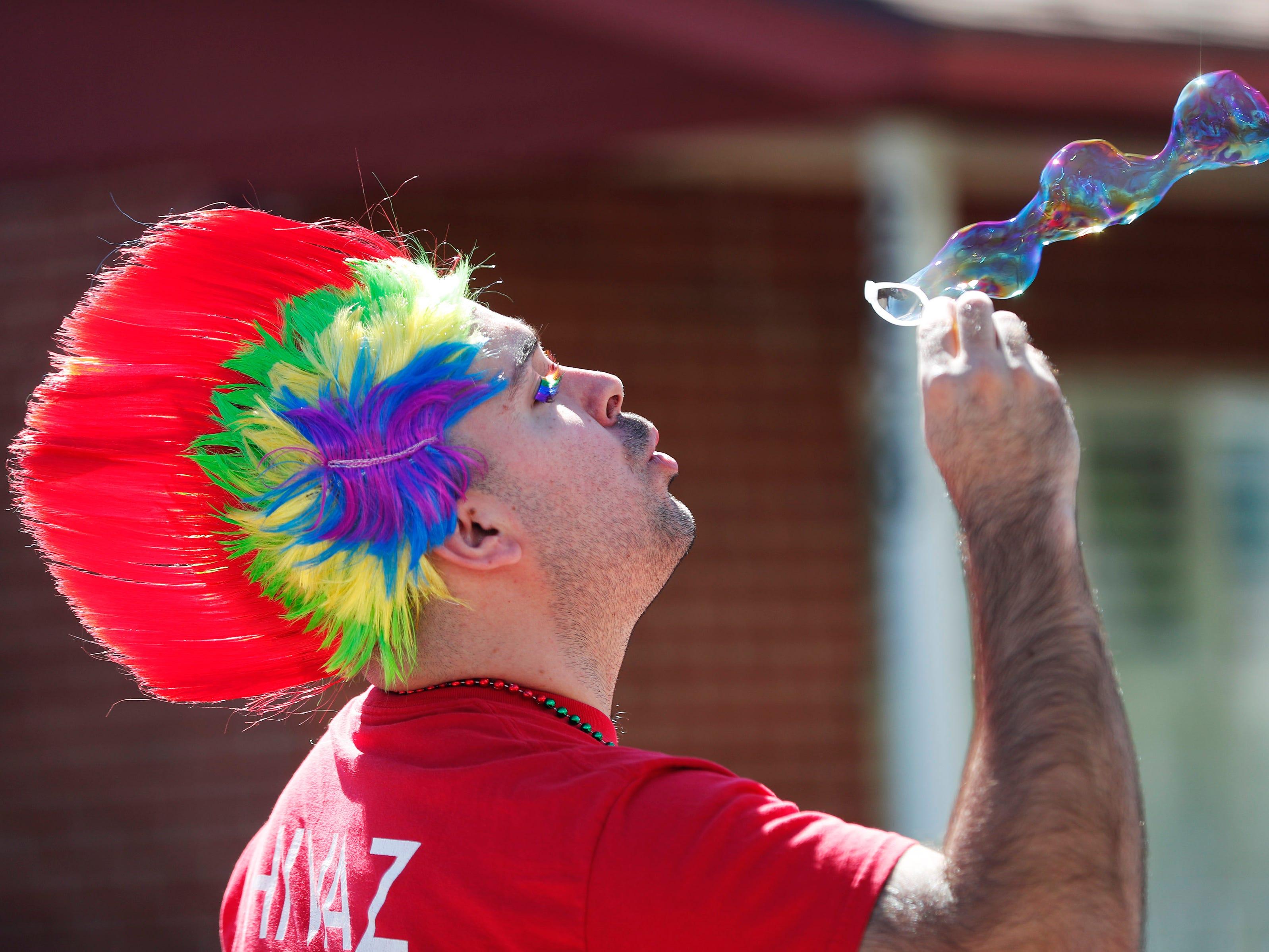 Mathew Scandin flows bubbles during the Phoenix Pride Parade on April 7, 2019.