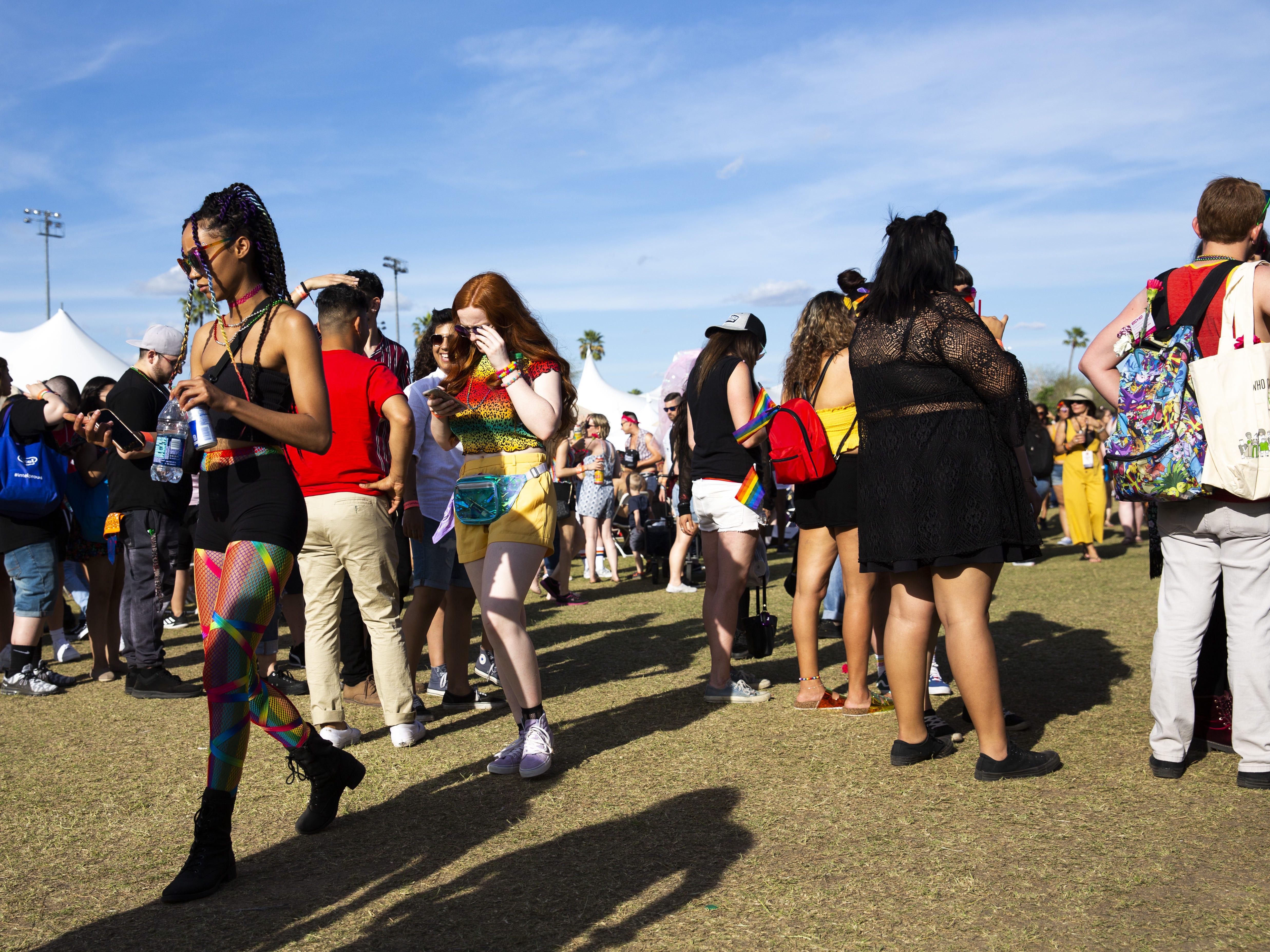 People wait in line to buy food during Phoenix Pride at Steele Indian School Park on Saturday, April 6, 2019.