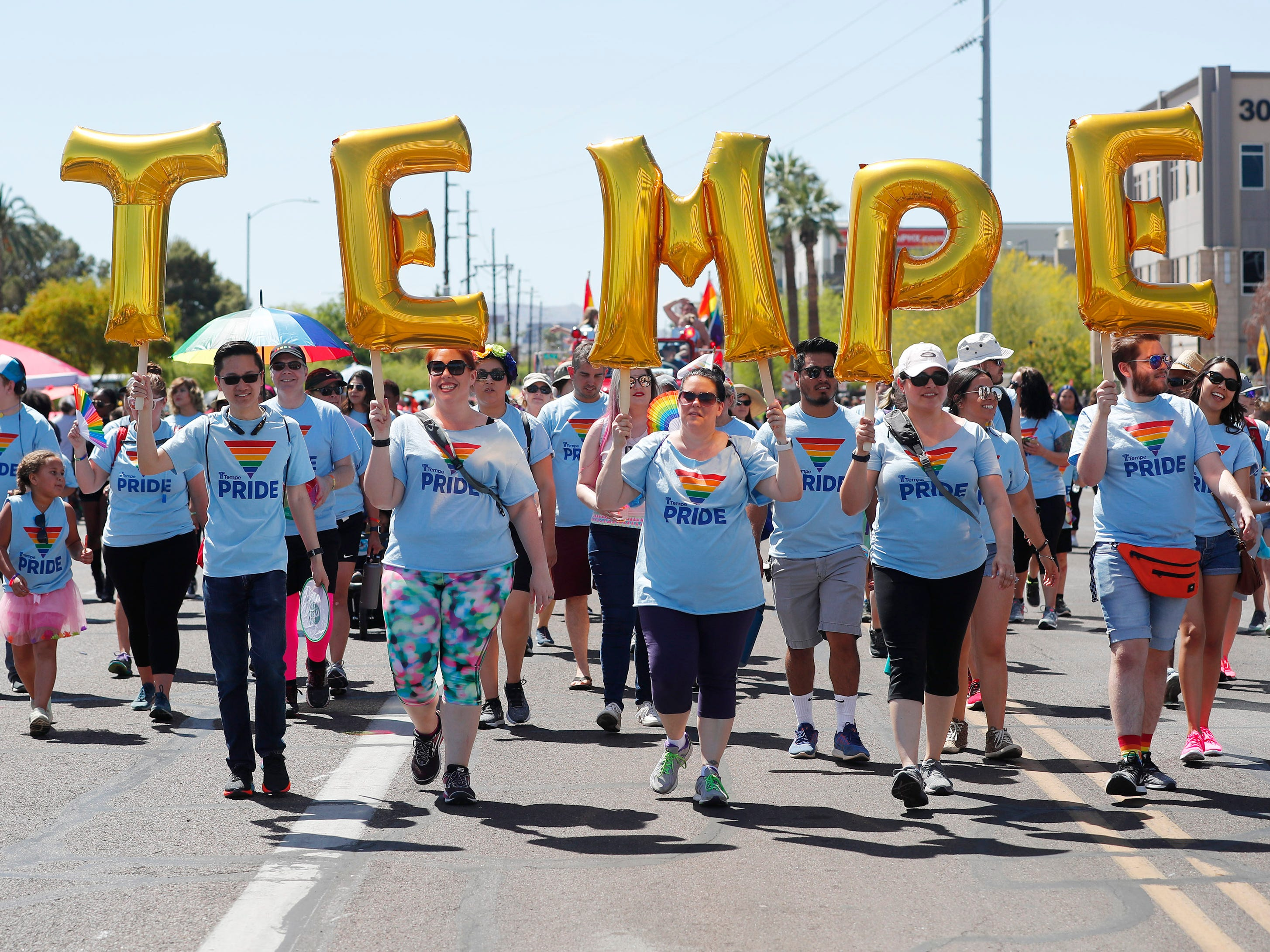 Participants with Tempe march during the Phoenix Pride Parade on April 7, 2019.
