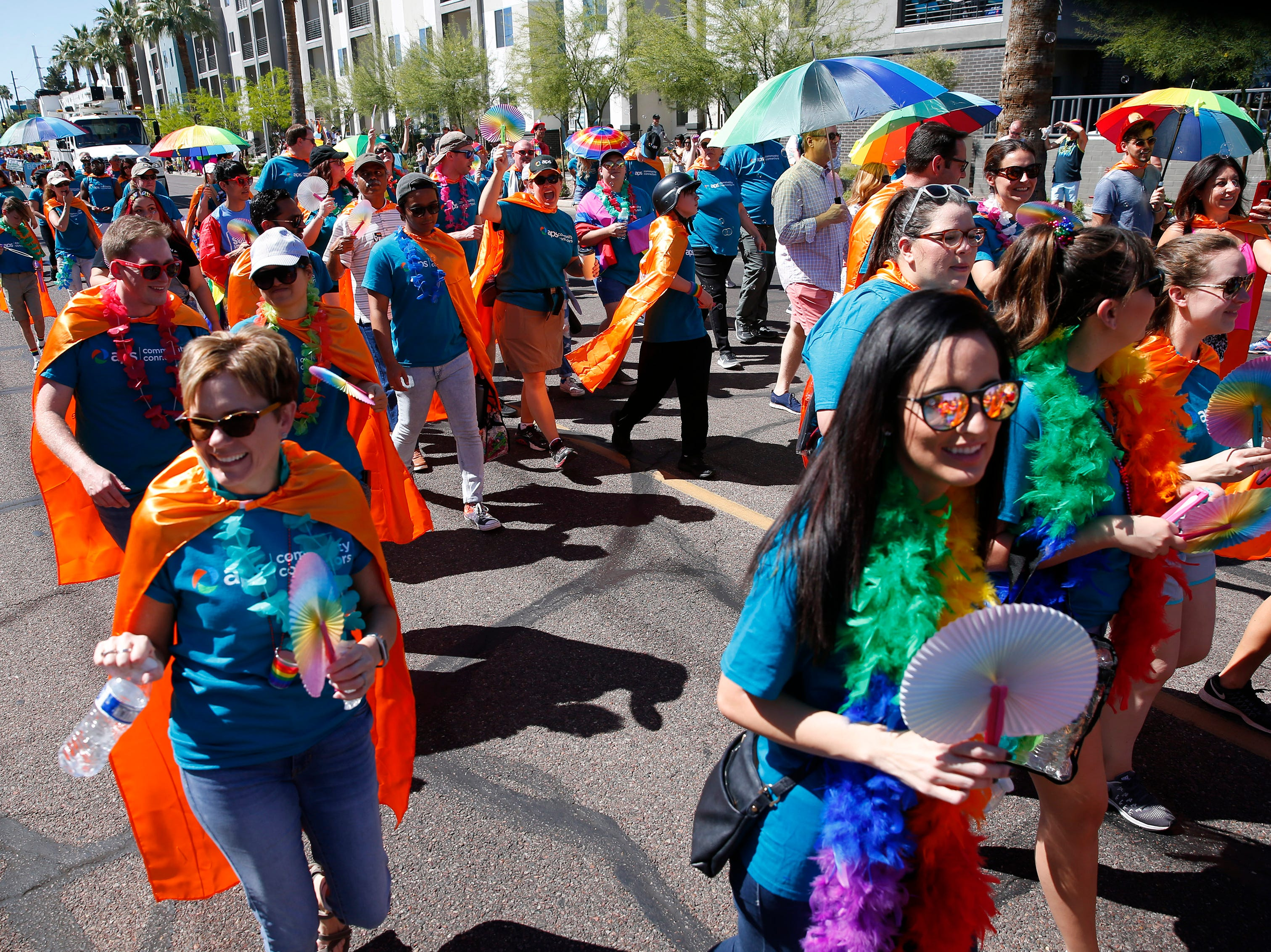 Participants with APS march during the Phoenix Pride Parade on April 7, 2019.