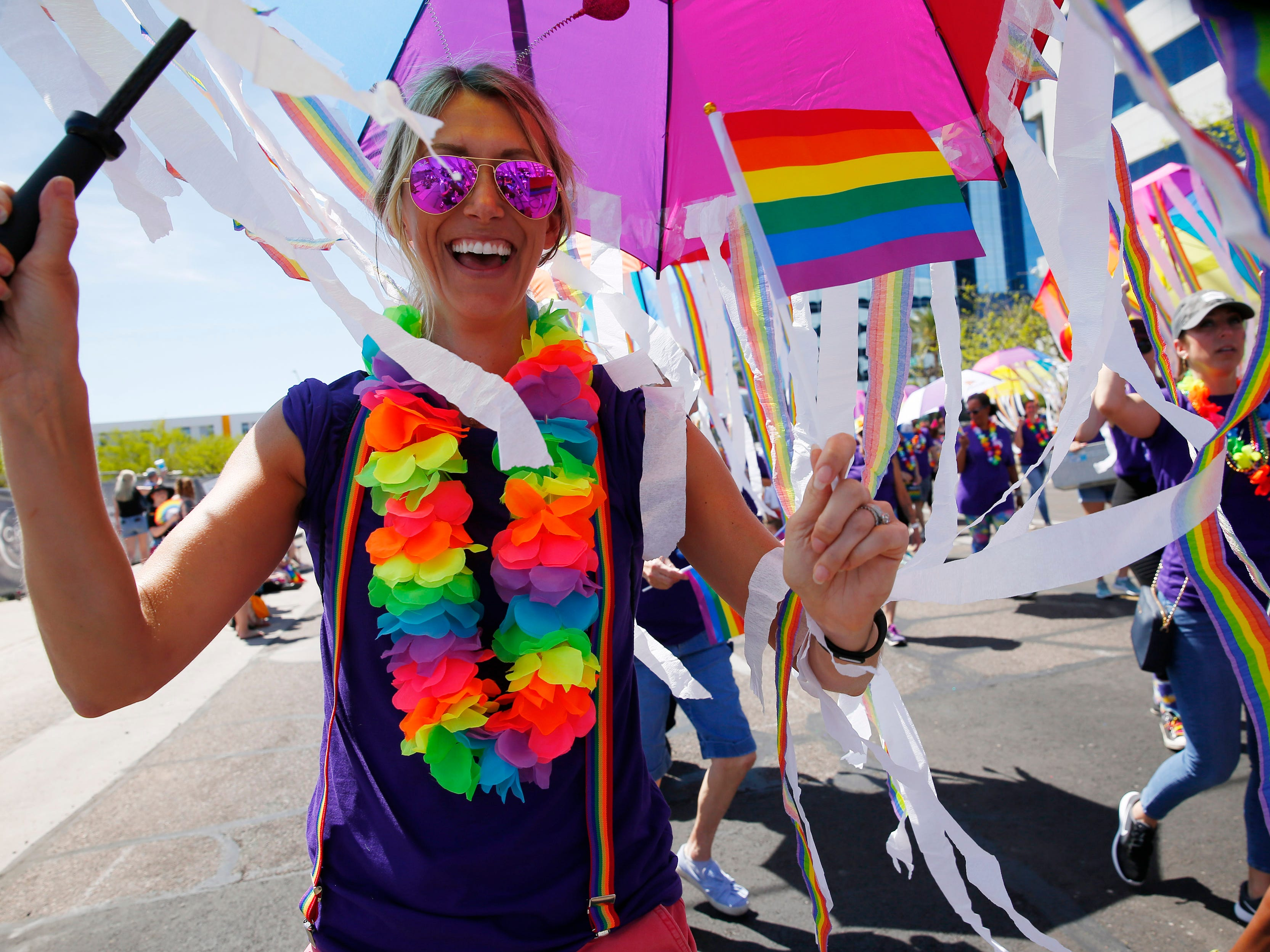 Abbey Miller marches with Edward Jones during the Phoenix Pride Parade on April 7, 2019.
