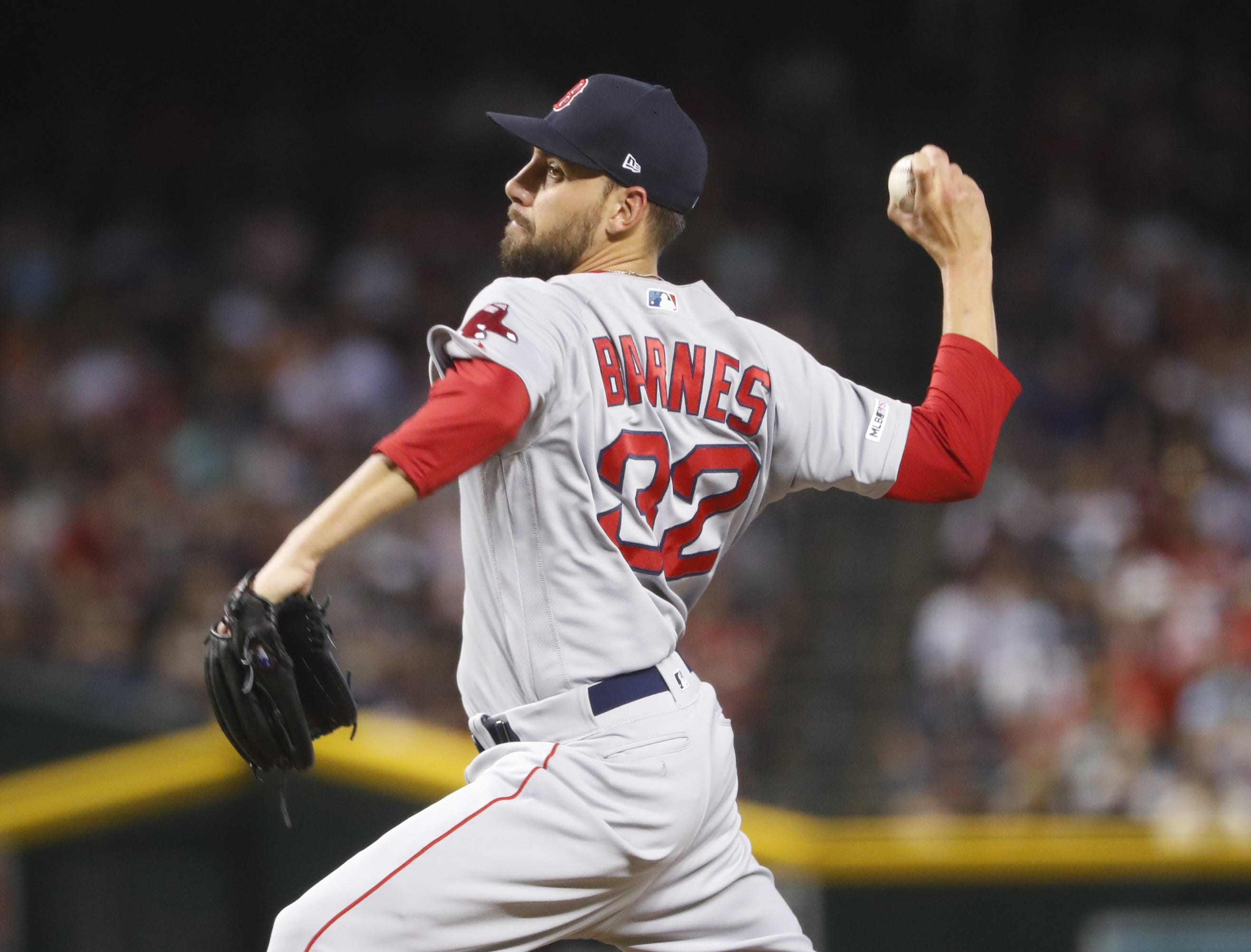 Red Sox Matt Barnes (32) pitches against the Diamondbacks during the eighth inning at Chase Field in Phoenix, Ariz. on April 7, 2019.