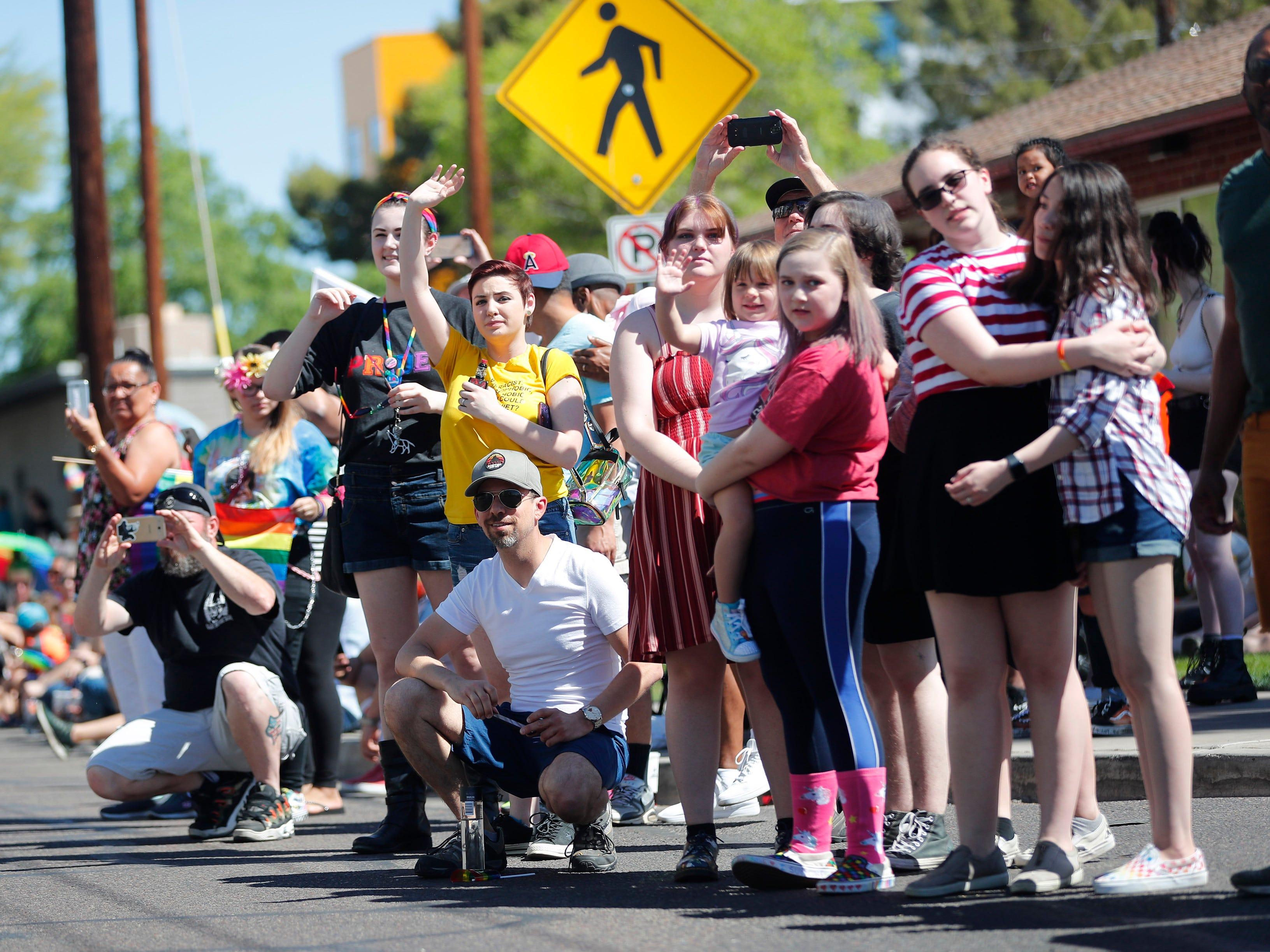 Spectators watch the Phoenix Pride Parade on April 7, 2019.