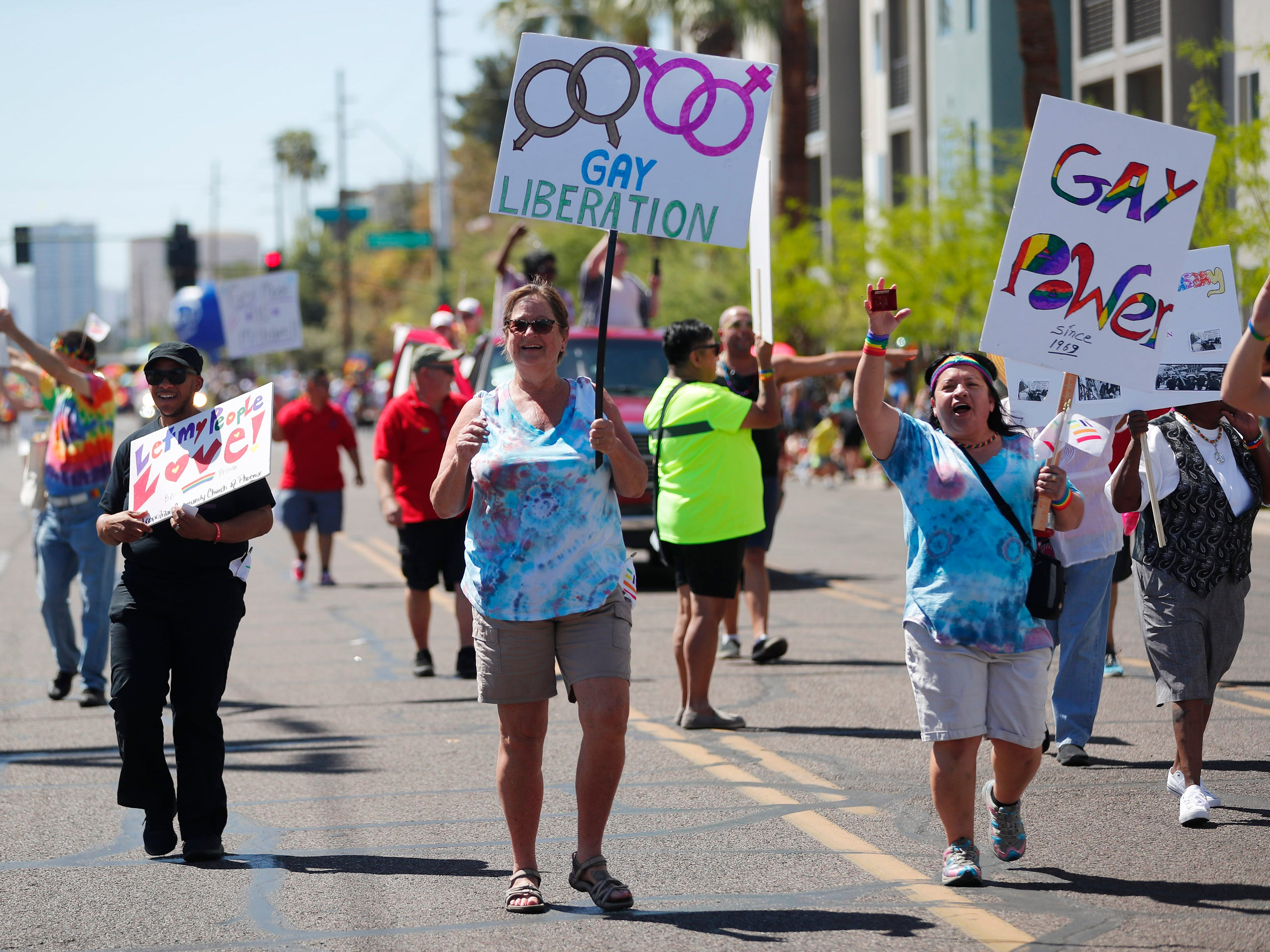 Participants with Metropolitan Community Church Phoenix march during the Phoenix Pride Parade on April 7, 2019.