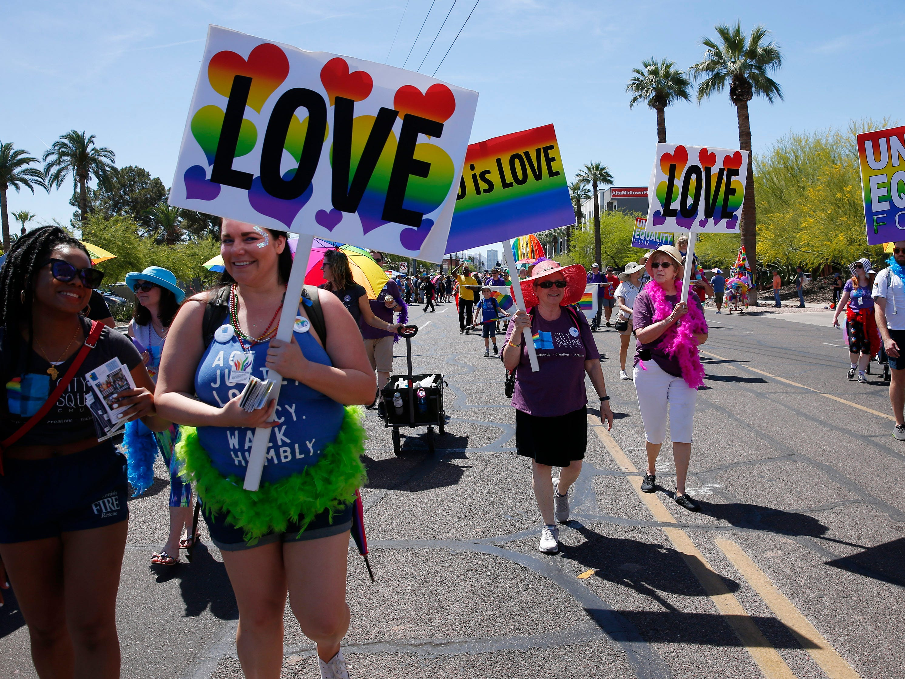 Participants with City Square Church march during the Phoenix Pride Parade on April 7, 2019.