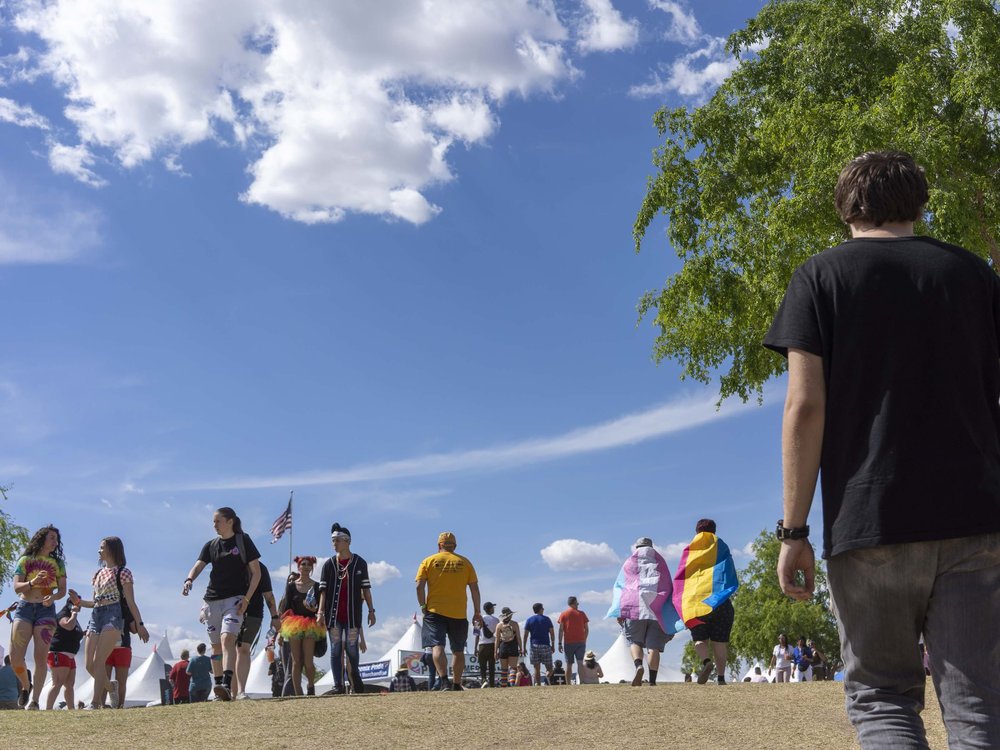 People attend Phoenix Pride with their friends at Steele Indian School Park on Saturday, April 6, 2019.