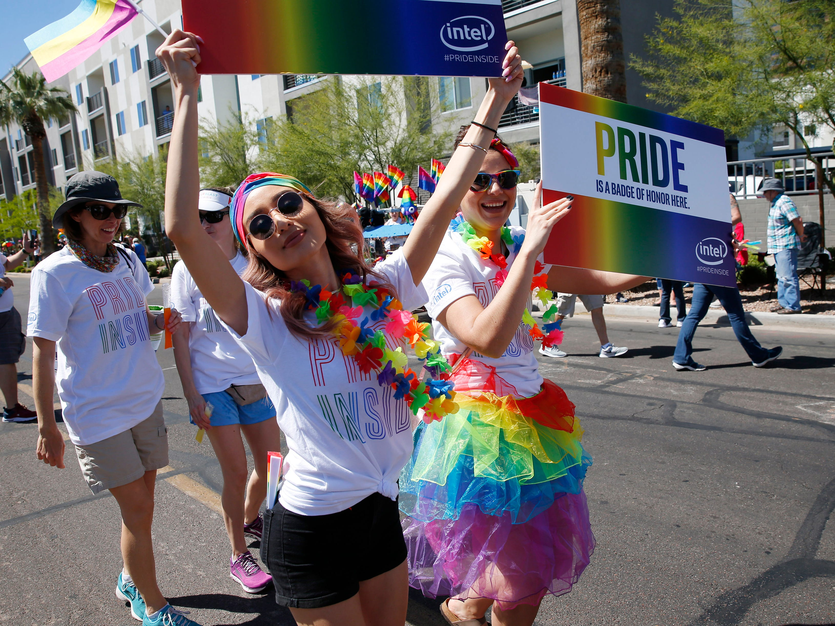Participants with Intel march during the Phoenix Pride Parade on April 7, 2019.