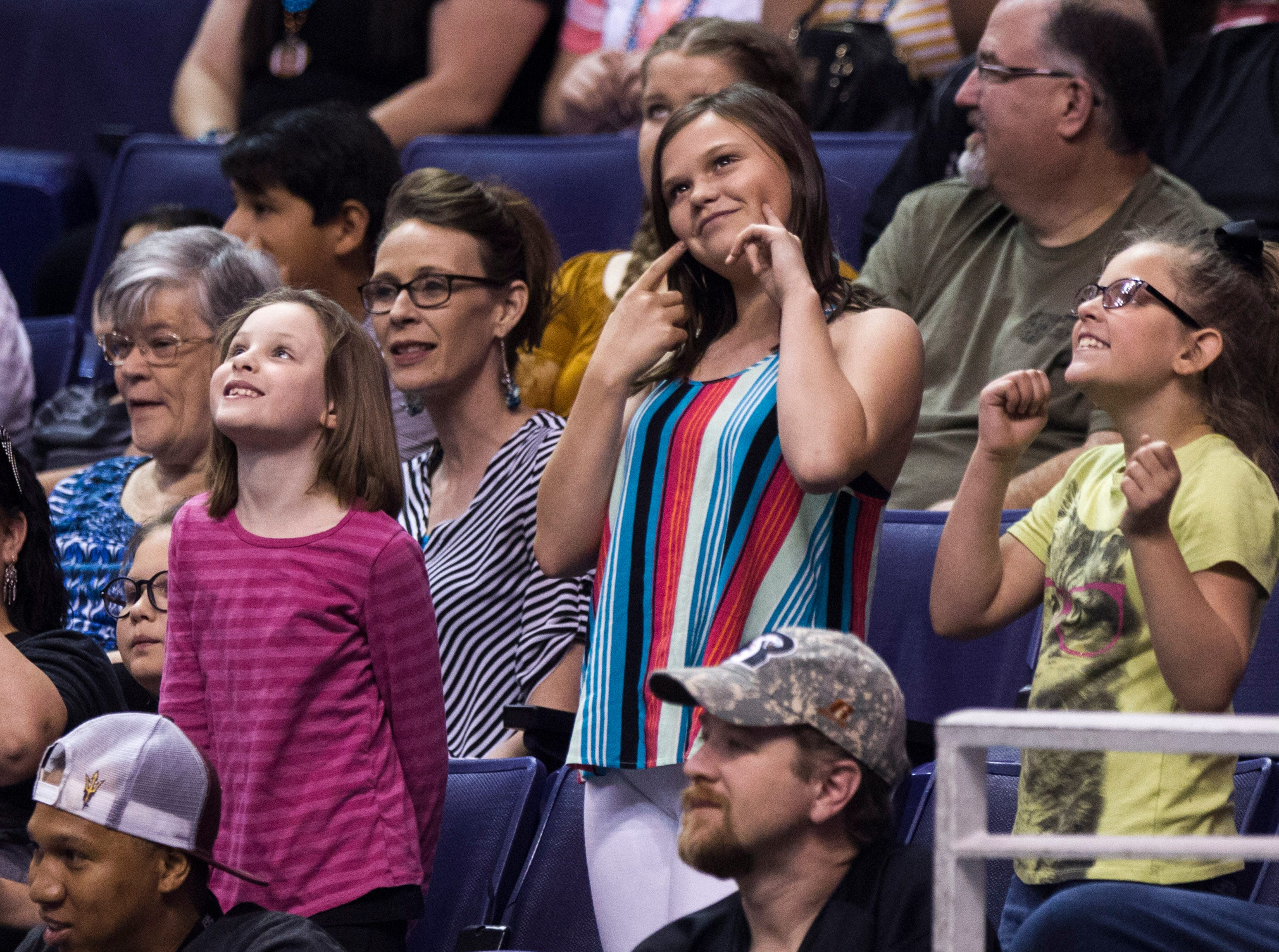 Arizona Rattlers fans ham it up during their game with the San Diego Strike Force at Talking Stick Resort Arena in Phoenix Friday, April. 6, 2019.