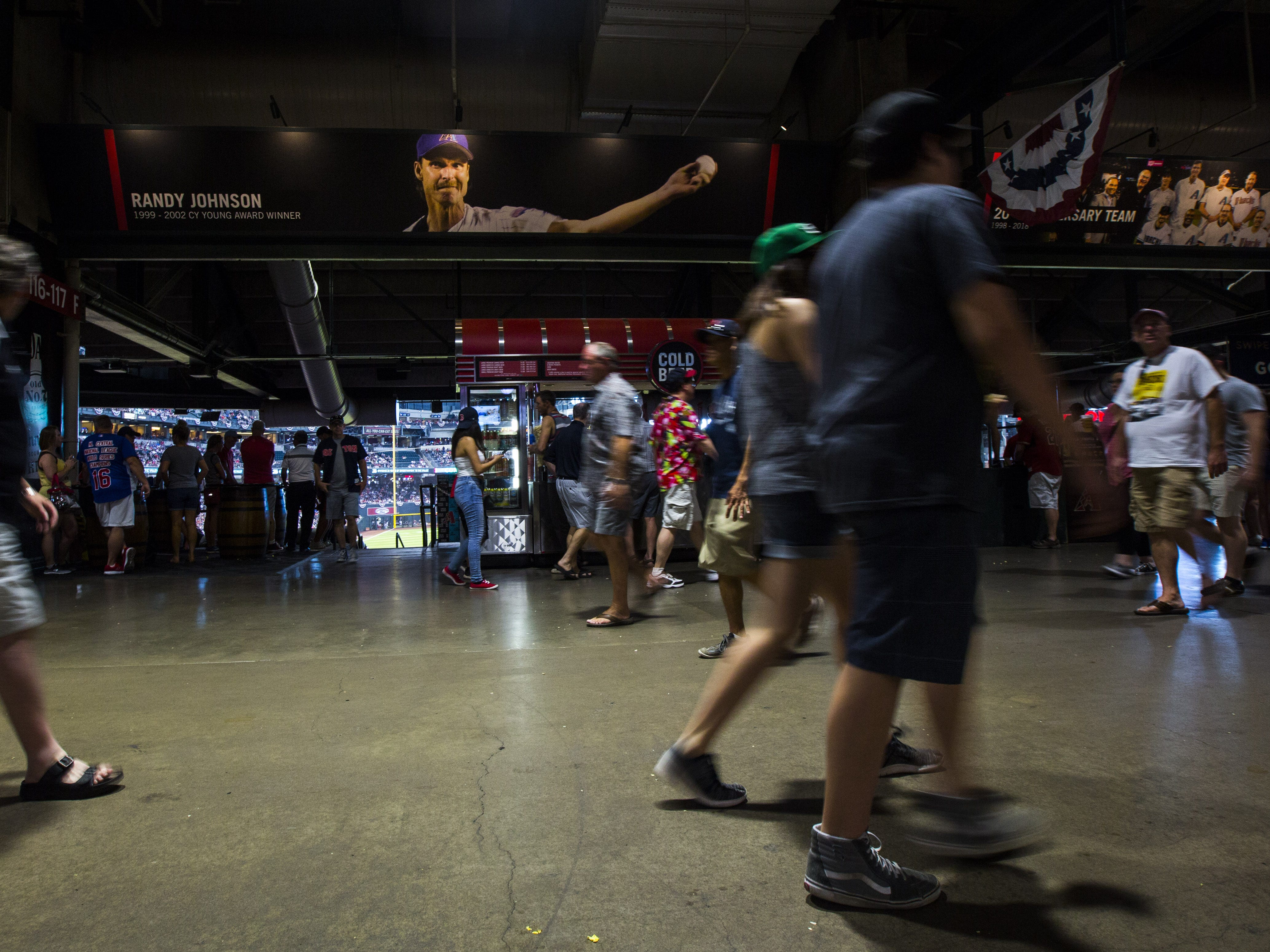 Fans make their way through the concourse level of Chase Field during the seventh inning of a Diamondbacks vs. Red Sox game in Phoenix, Ariz. on April 7, 2019.