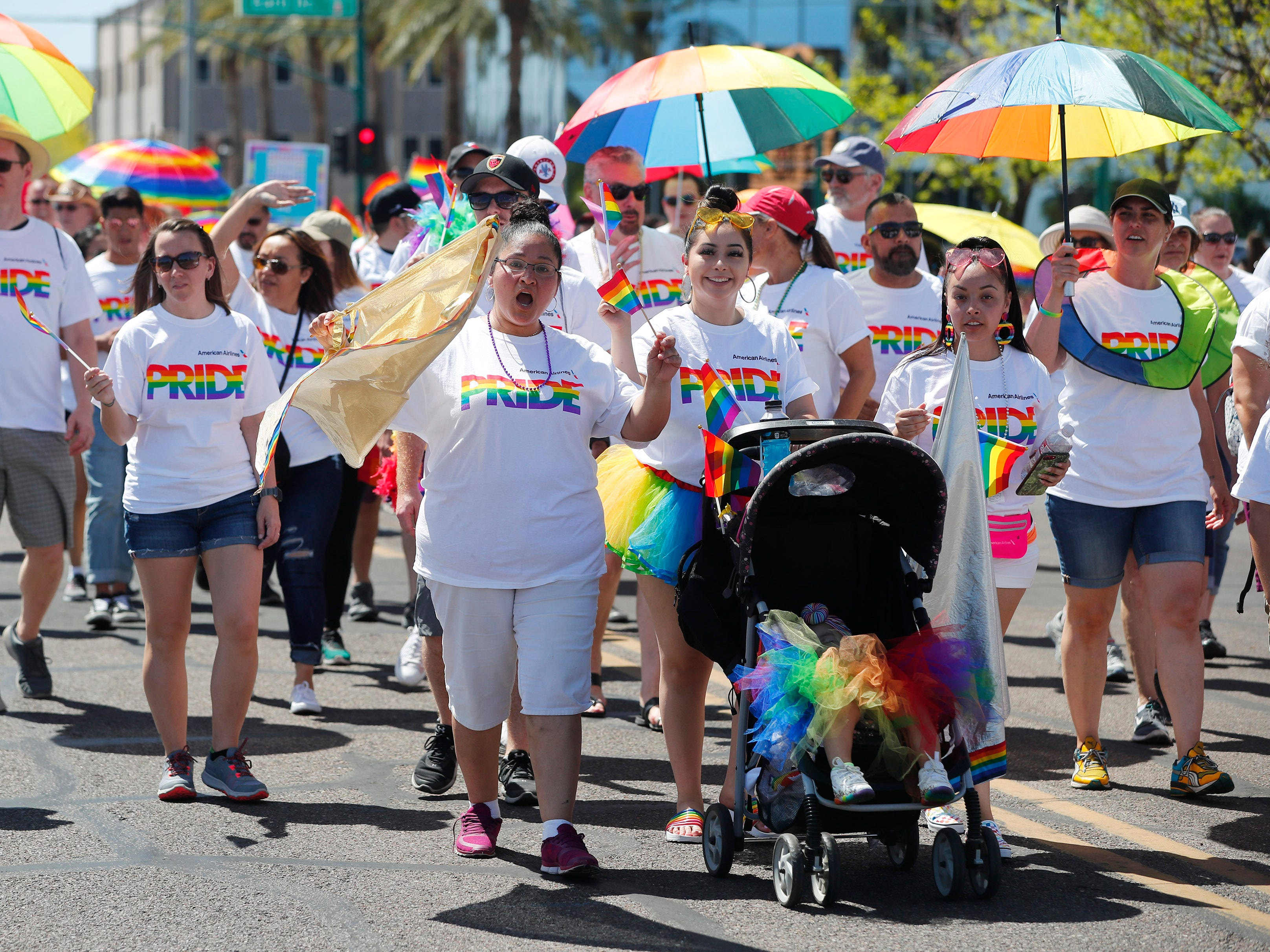 Participants with American Airlines march during the Phoenix Pride Parade on April 7, 2019.