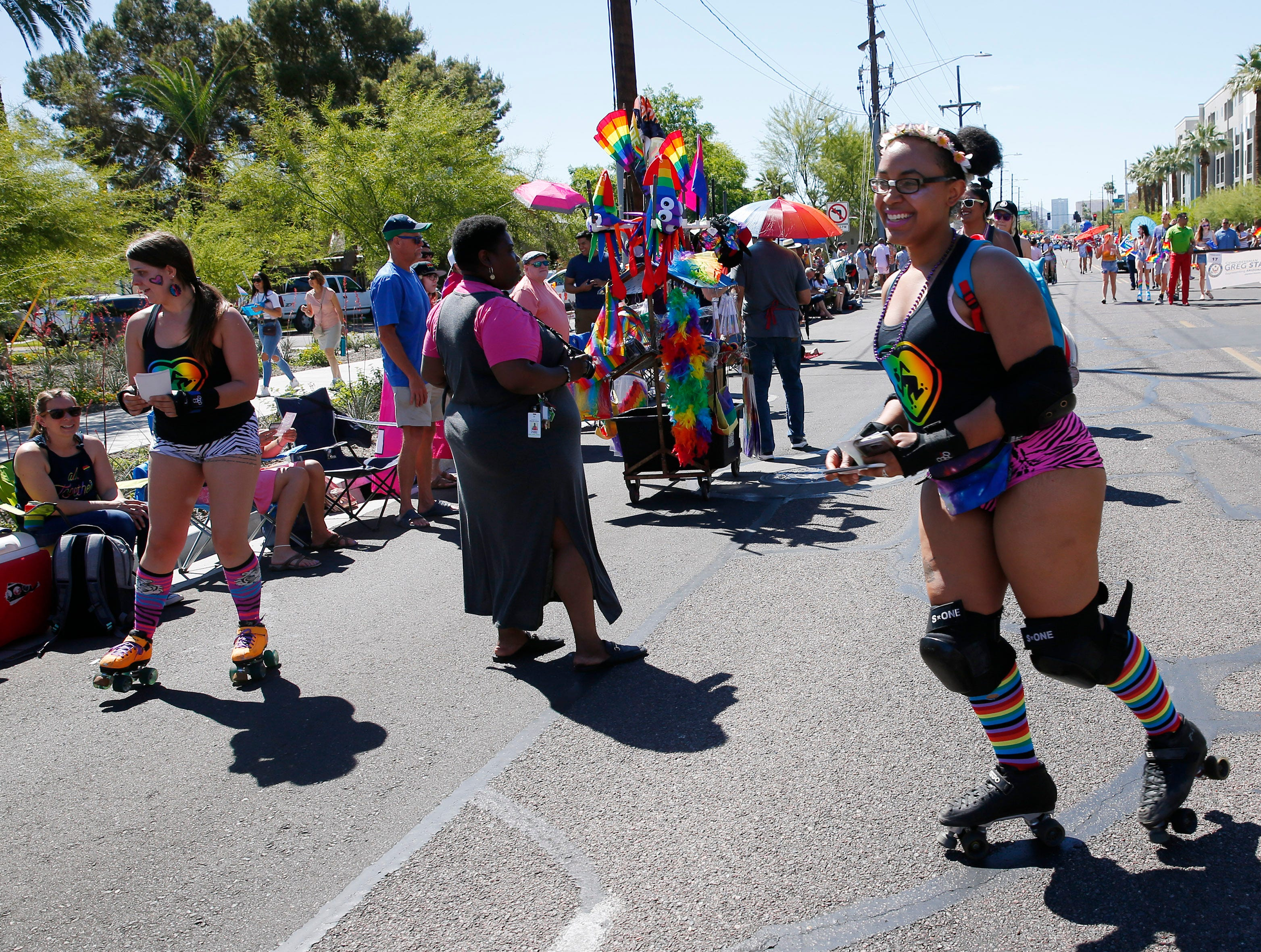 Members of Arizona Roller Derby participates in the Phoenix Pride Parade on April 7, 2019.