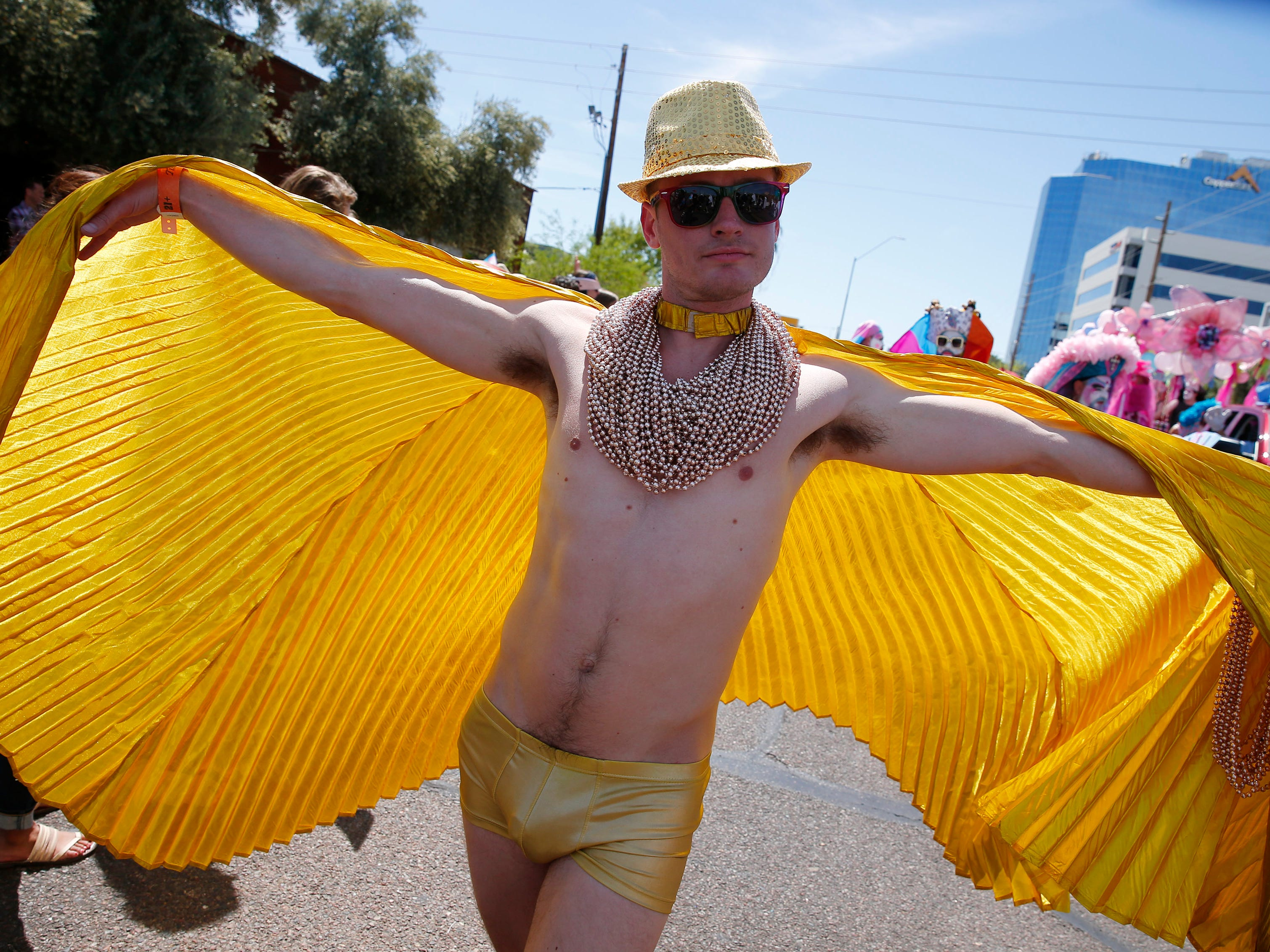A member of the Grand Canyon Sisters of Perpetual Indulgence march during the Phoenix Pride Parade on April 7, 2019.