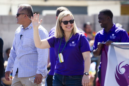Phoenix Mayor Kate Gallego marches with a group clad in purple in the Phoenix Pride Parade on April 7, 2019.