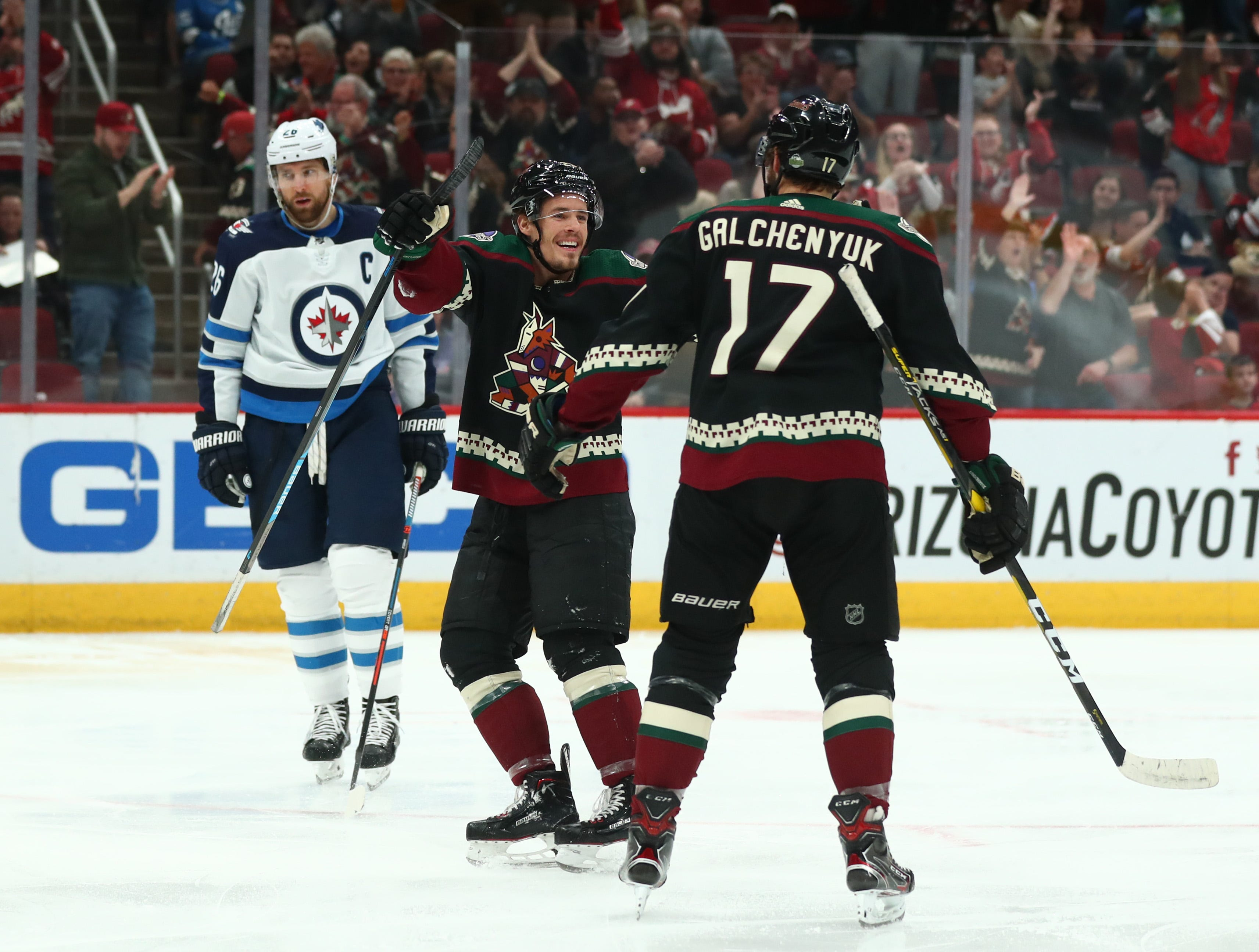 Apr 6, 2019; Glendale, AZ, USA; Arizona Coyotes center Alex Galchenyuk (17) and Nick Cousins (25) celebrate a goal against the Winnipeg Jets in the first period at Gila River Arena. Mandatory Credit: Mark J. Rebilas-USA TODAY Sports