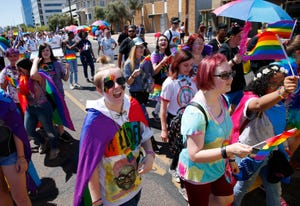 Participants with Greenway and Moon Valley High march during the Phoenix Pride Parade on April 7, 2019.
