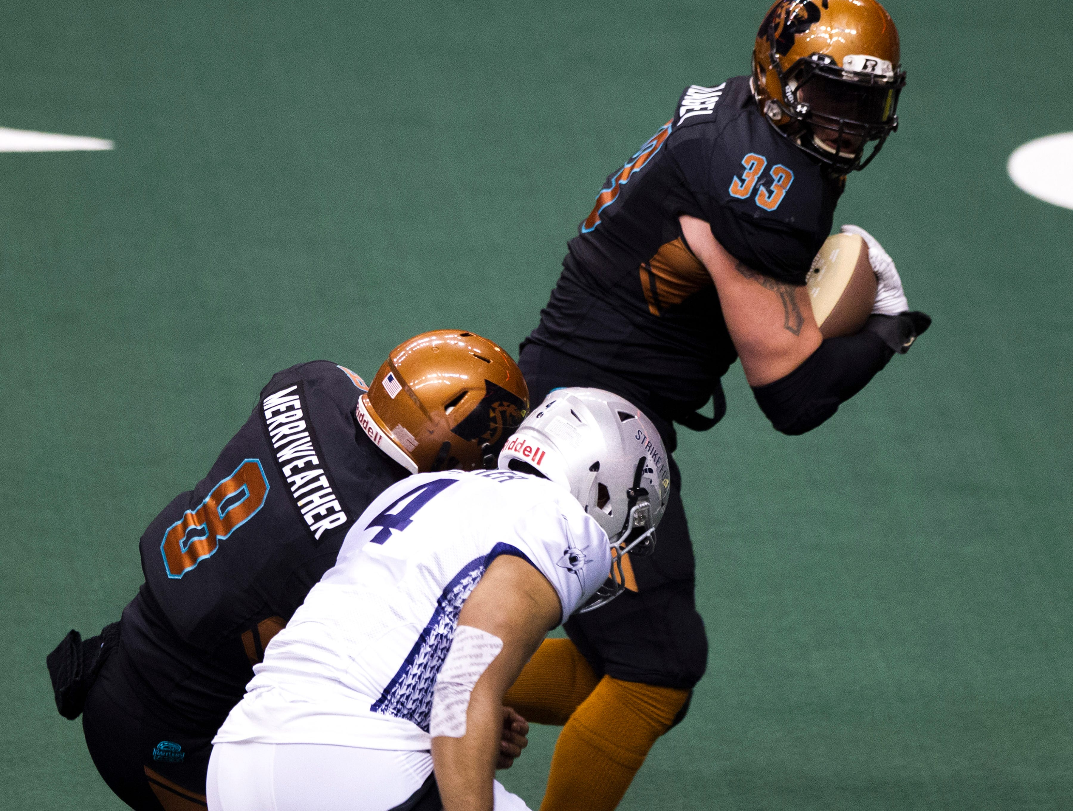 Arizona Rattlers' Connor Flagel (33) gets a block from Davontee Merriweather (8) as he runs in a fumble for a touchdown against San Diego Strike Force during the first half of their game at Talking Stick Resort Arena in Phoenix Friday, April. 6, 2019.