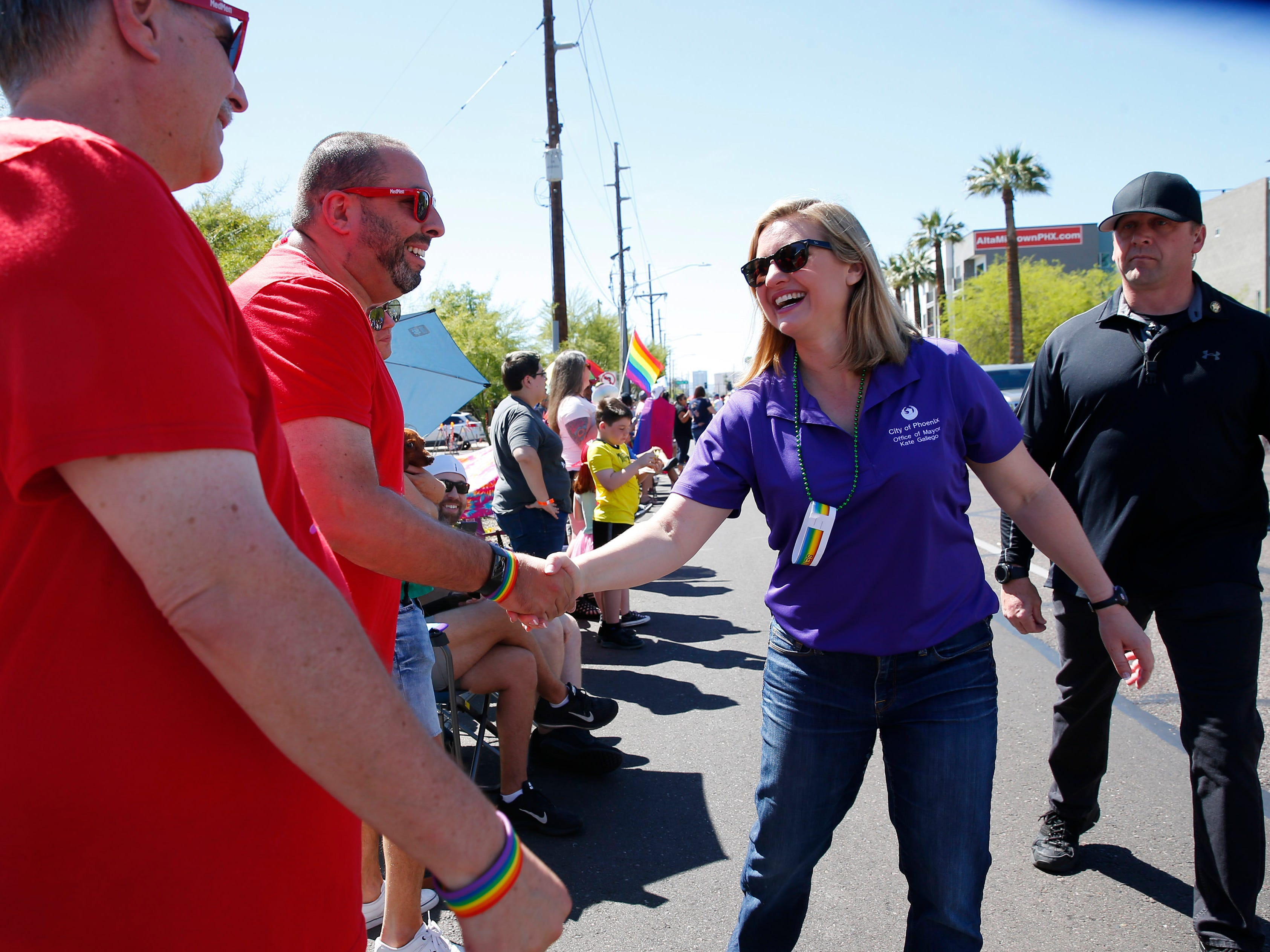 Phoenix Mayor Kate Gallego shakes hands during the Phoenix Pride Parade on April 7, 2019.