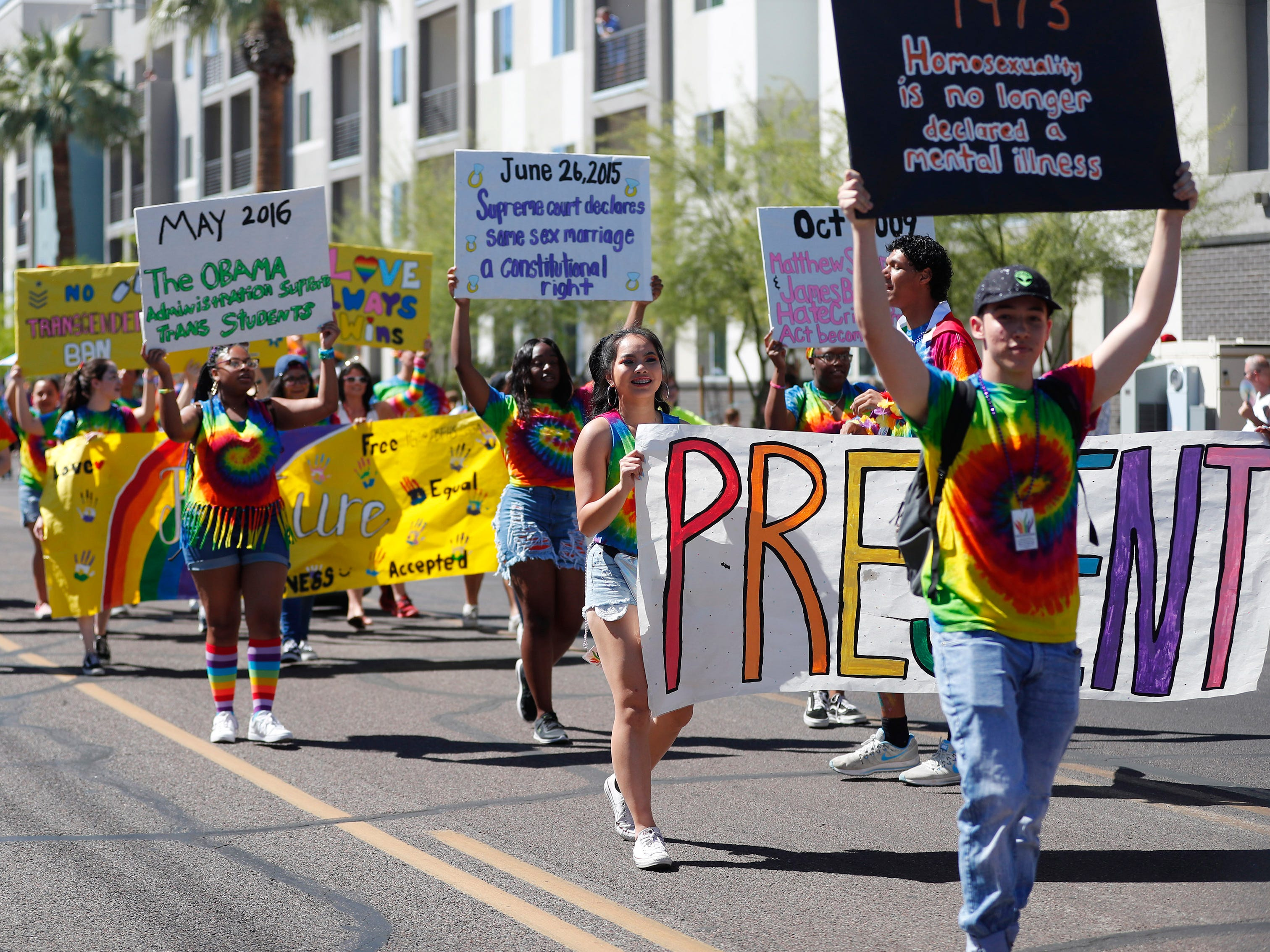 Participants with Betty H. Fairfax GSA march during the Phoenix Pride Parade on April 7, 2019.