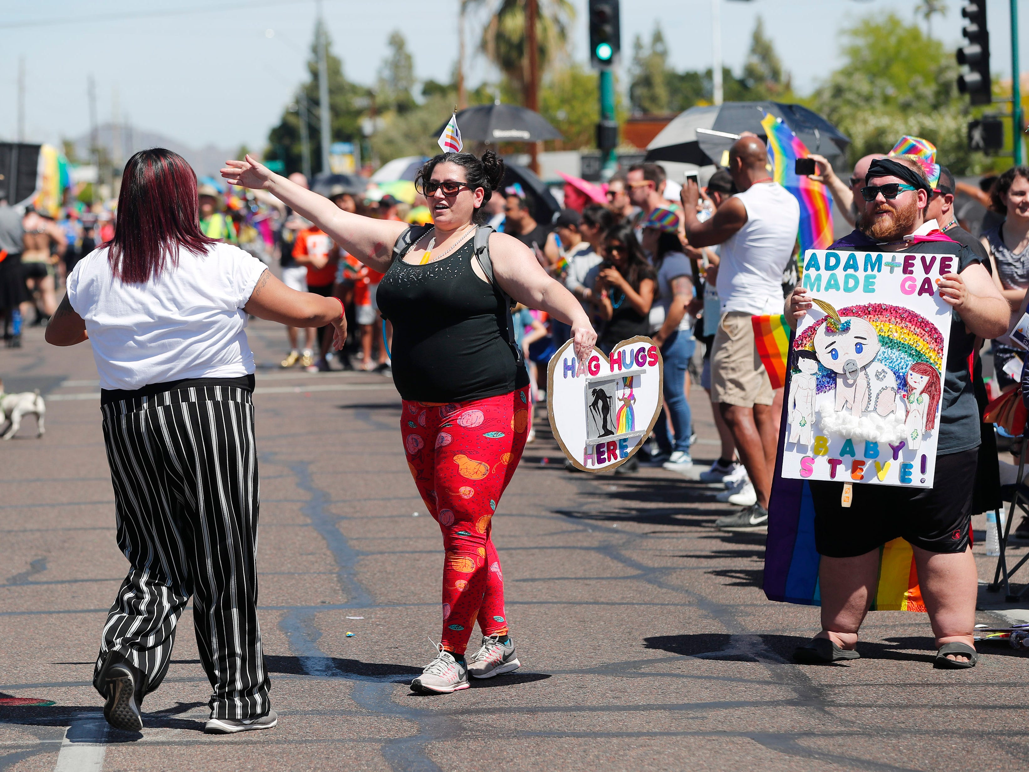 Karen Otero (right) gives a hug to Charms during the Phoenix Pride Parade on April 7, 2019.